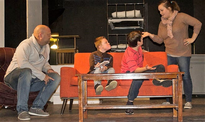 """Josh Blau (The Old Man), left, watches as Cate Kopkey (Mother) lecture Sebastian Surber (Randy) and Kael Pierquet (Ralphie) during a rehearsal of """"A Christmas Story: The Musical.""""  to presented in December by Abrams Spotlight Productions Inc."""