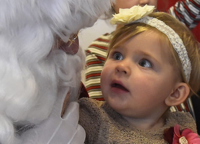 "Alexis Zielke's blue eyes couldn't get any bigger as the Sister Bay toddler meets Santa Claus during last year's ""Christmas In the Village"" in Ephraim."