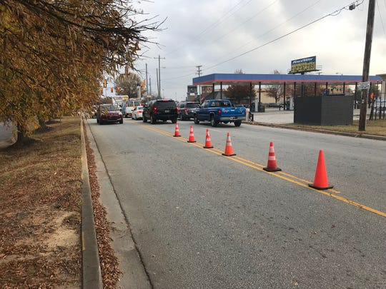 Barriers on Woodruff Industrial Lane help traffic move.