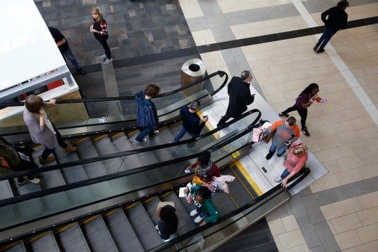 Shoppers walk around Haywood Mall Friday, Nov. 23, 2018.