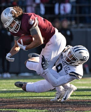 Montana State's Jalen Cole brings down Montana receiver Jerry Louie-McGee during the 2018 Cats-Griz game at Washington-Grizzly Stadium in Missoula.