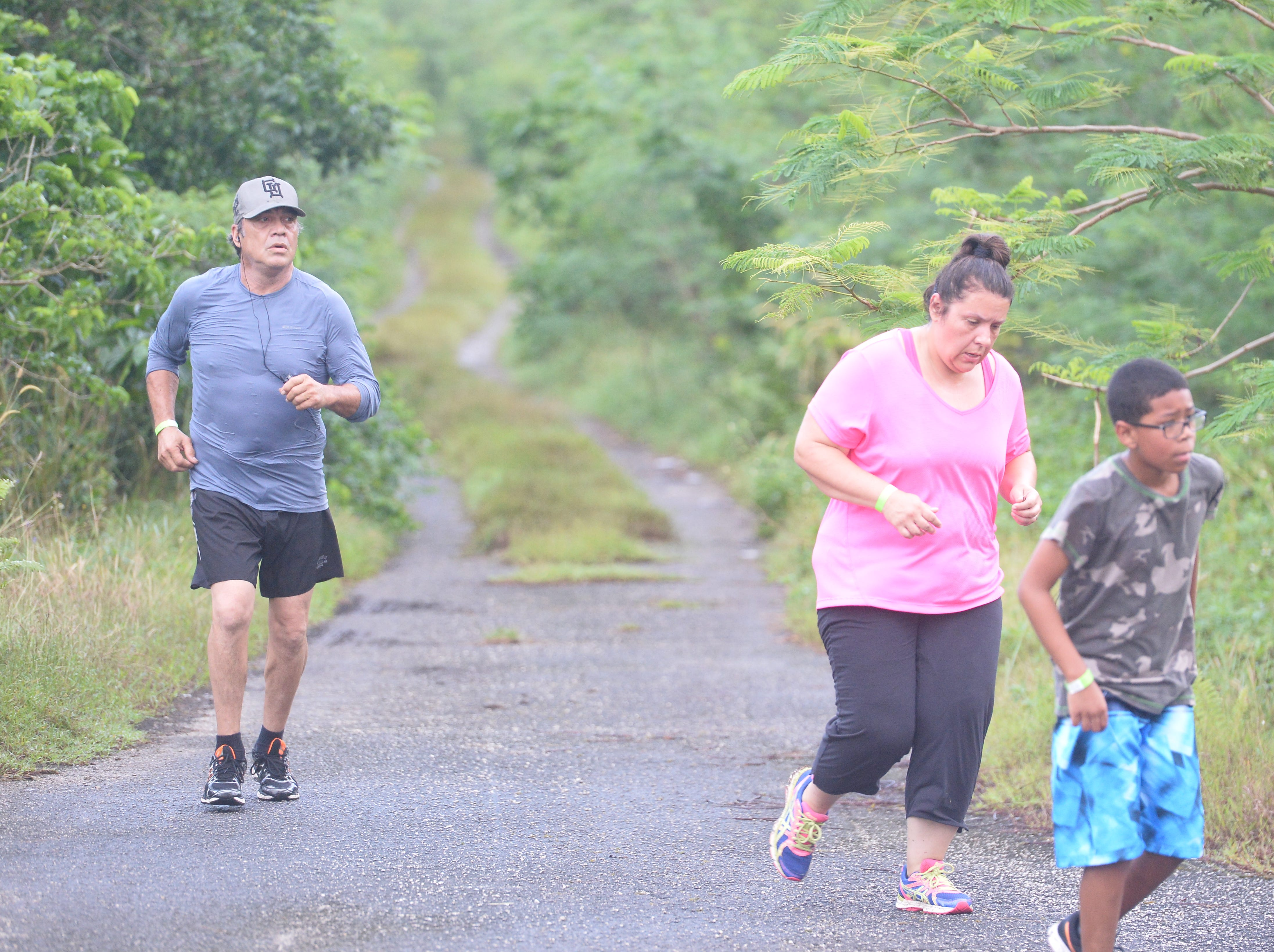 Scenes from the Guam Running Club's 48th Annual Turkey Trot. It is the GRC's only staggered-start race, which allows slower runners a chance at a top-10 finish.