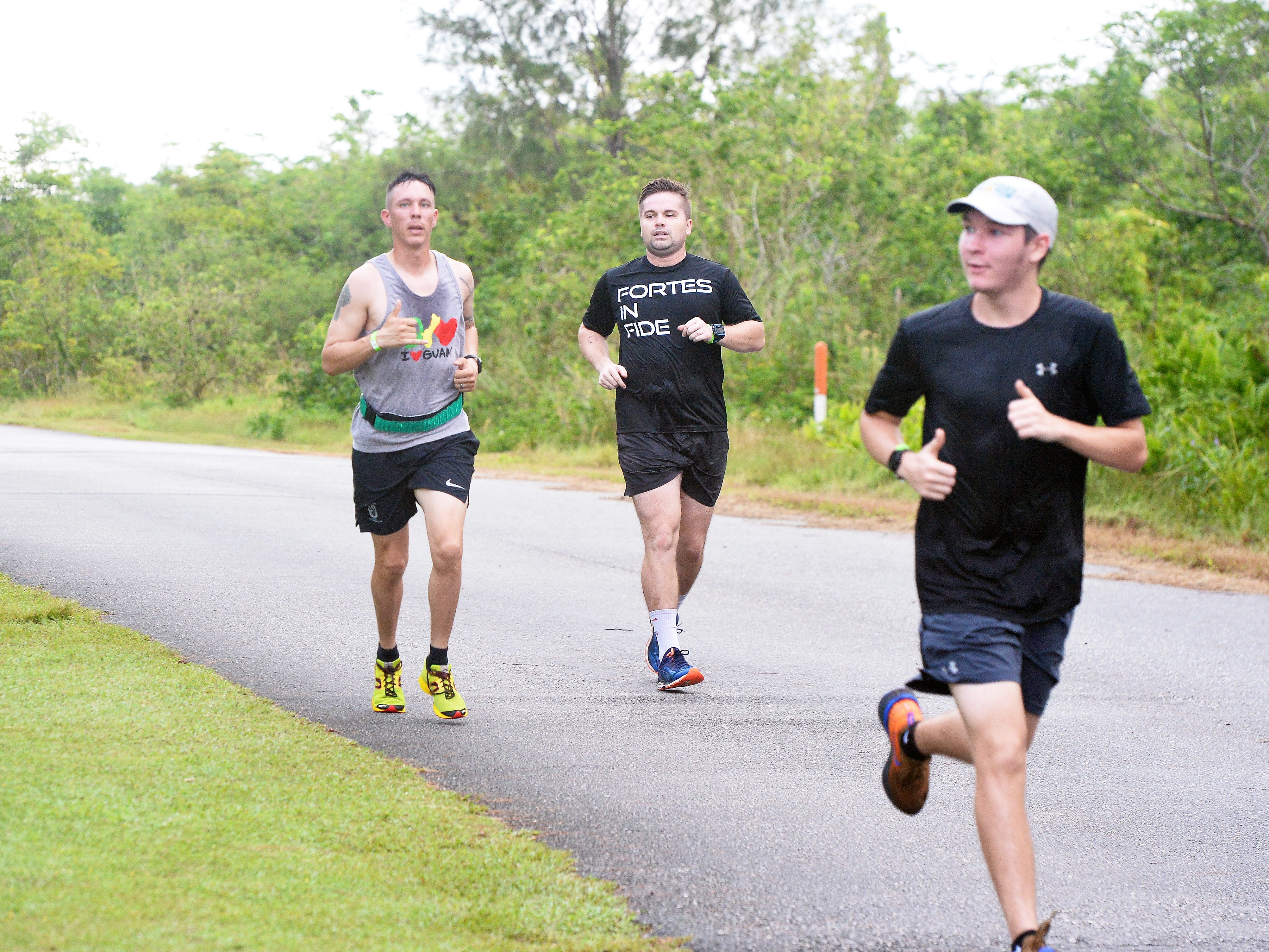 Scenes from the Guam Running Club's Annual Turkey Trot held Friday morning in the area leading up to Two Lover's Point. The race was postponed from Thanksgiving morning.