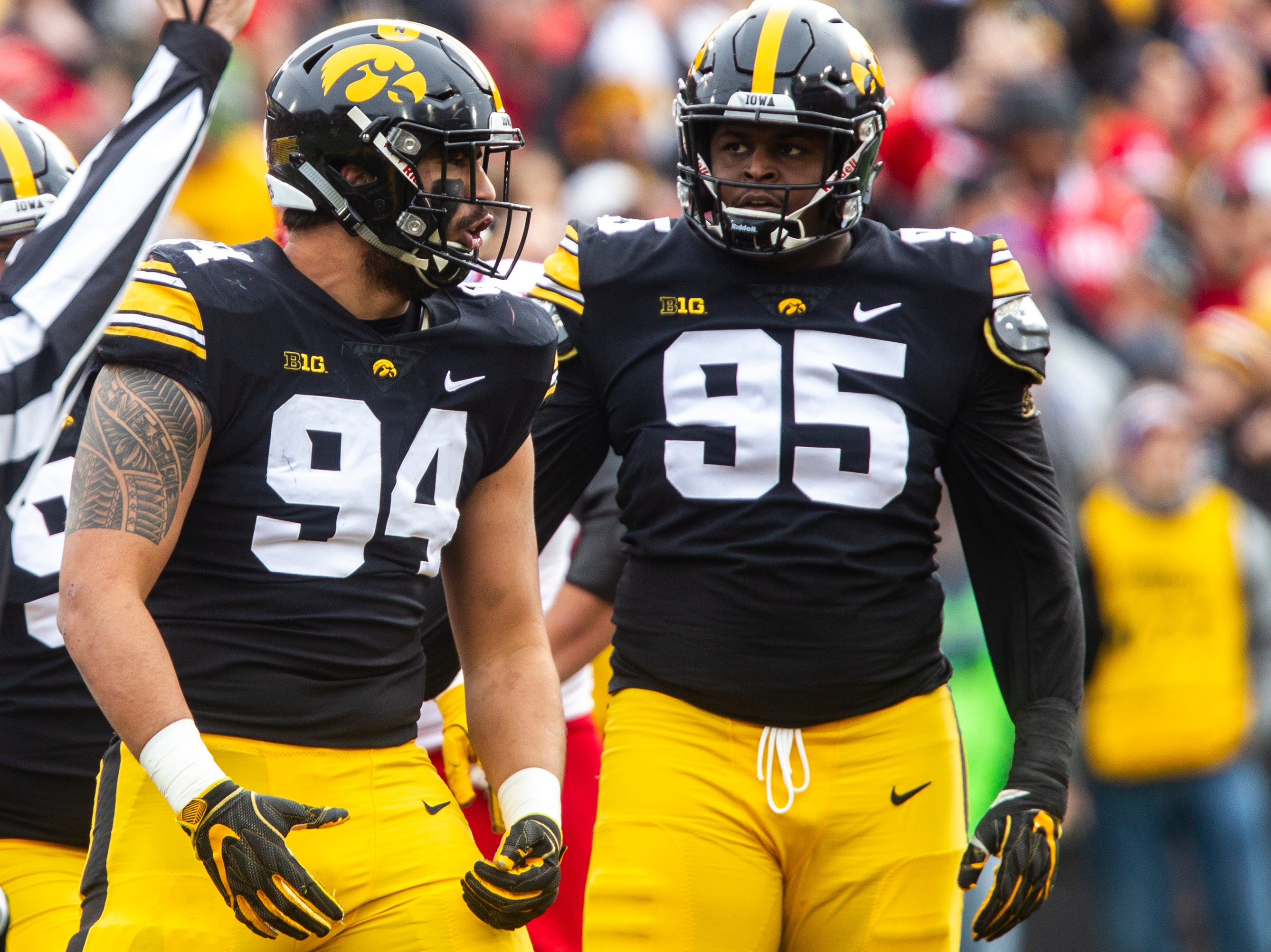 Iowa defensive end A.J. Epenesa (94) celebrates a sack with Iowa defensive lineman Cedrick Lattimore (95) during a Big Ten Conference NCAA football game on Friday, Nov. 23, 2018, at Kinnick Stadium in Iowa City.