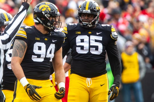 A.J. Epenesa (94) and Cedrick Lattimore (95) figure to be starters on Iowa's 2019 defensive line. But they're going to need some backups, too, and the Hawkeyes are feverishly trying to find some.