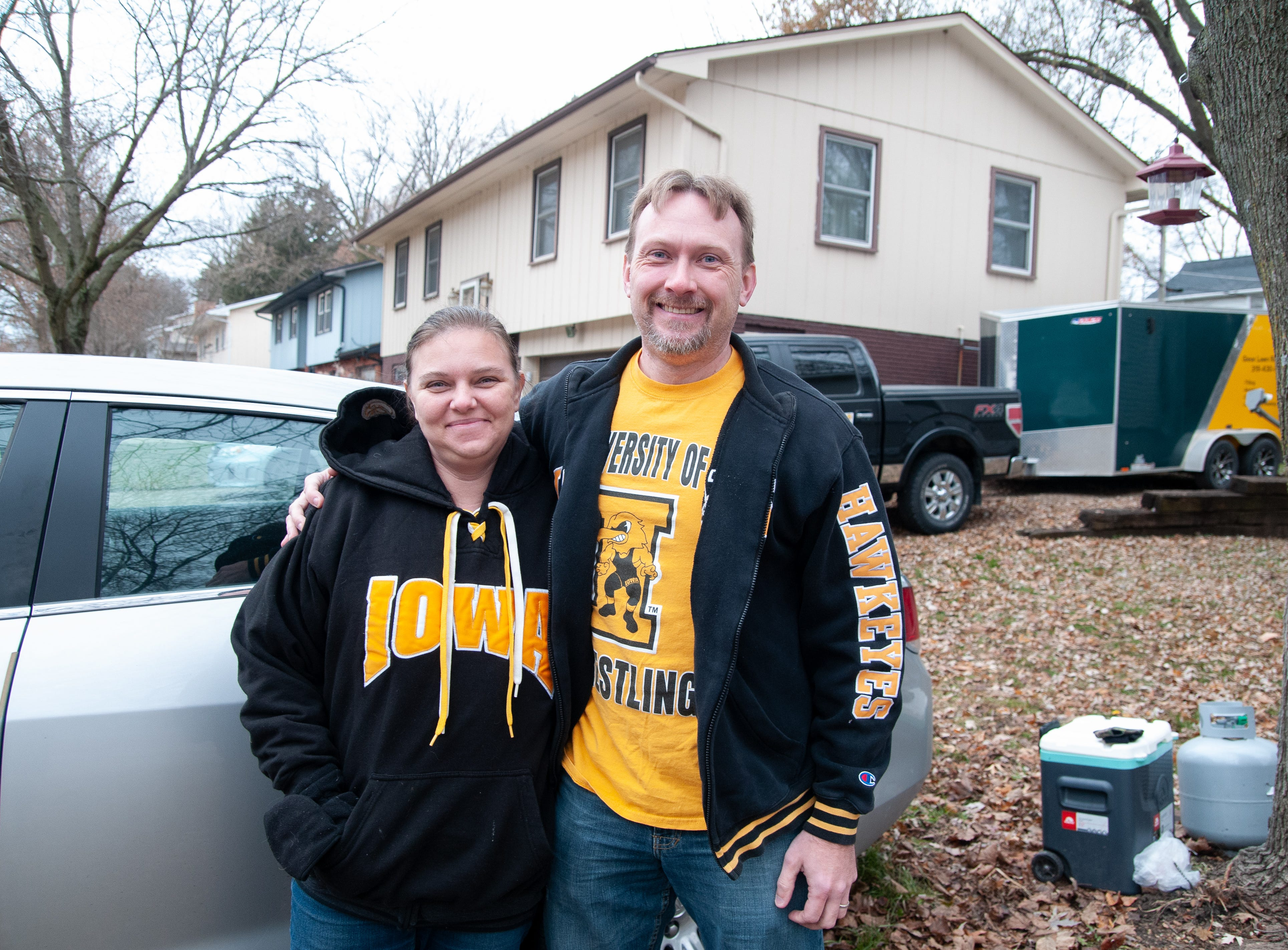 Julee, left, and Heath Reed, of Davenport, Friday, Nov. 23, 2018, while tailgating before the Iowa game against Nebraska in Iowa City.
