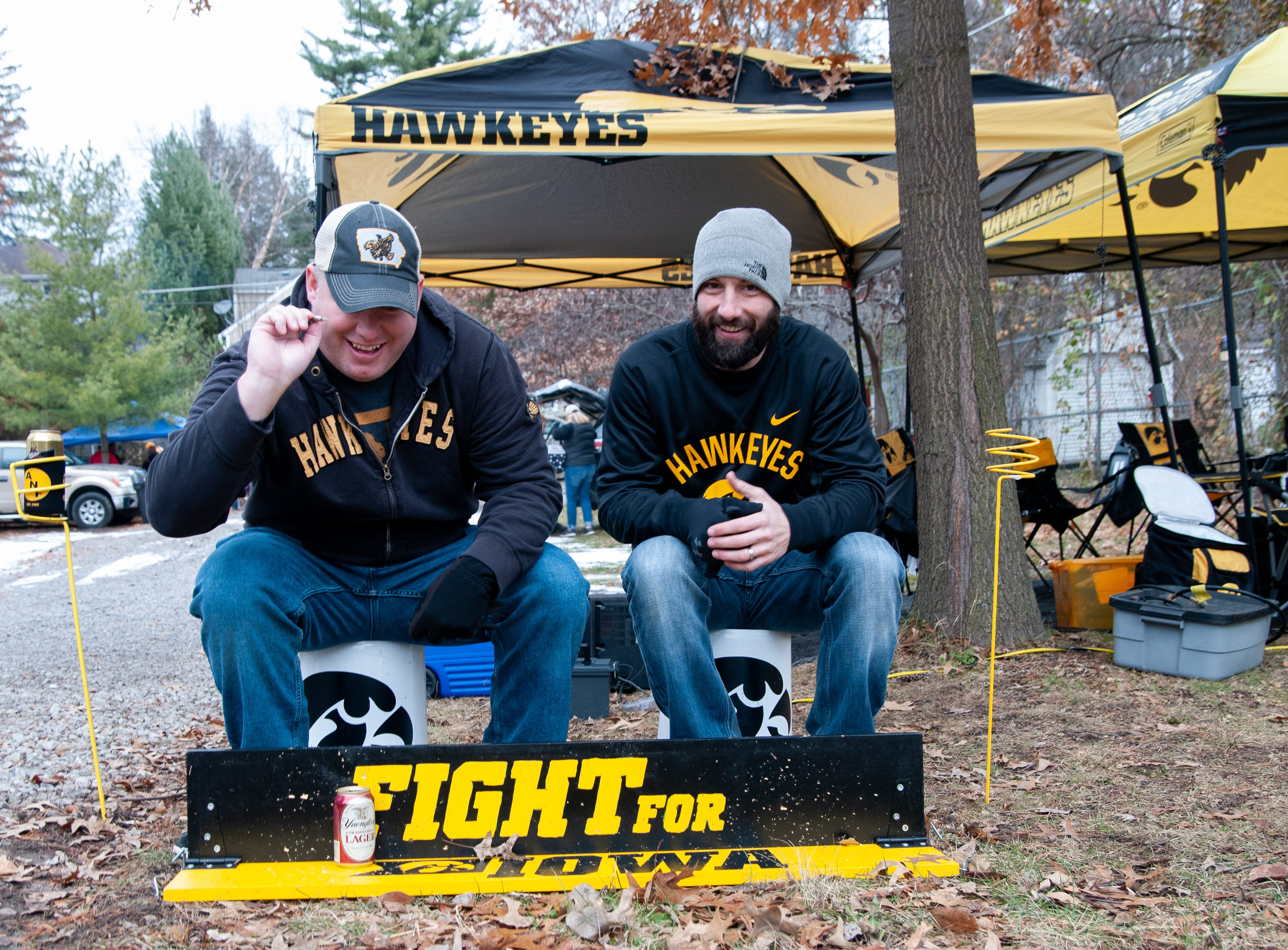 Eric Lyons, left, and Seith Monahan, of Des Moines, Friday, Nov. 23, 2018, while tailgating before the Iowa game against Nebraska in Iowa City.