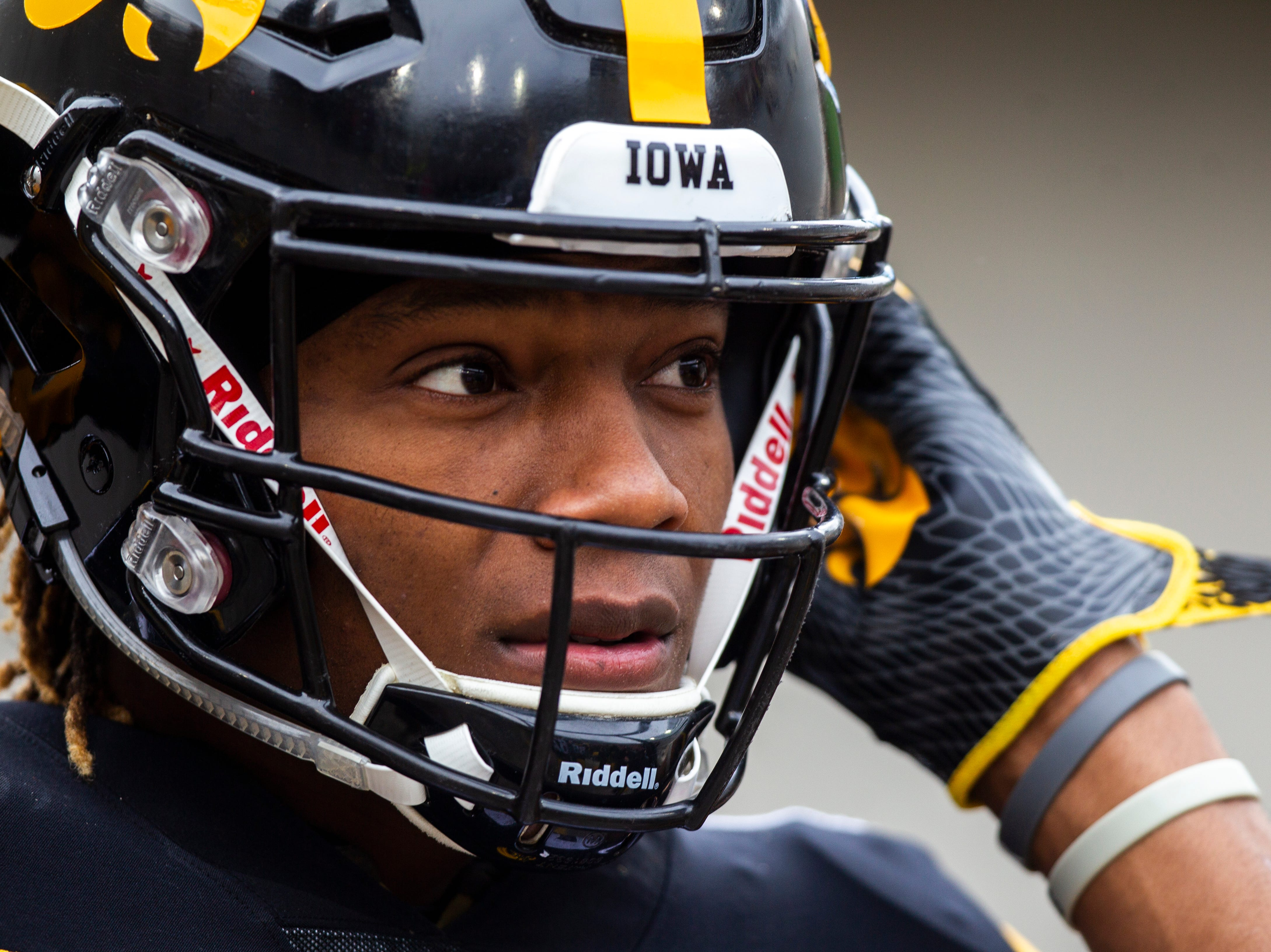 Iowa wide receiver Brandon Smith (12) walks onto the field before a Big Ten Conference NCAA football game on Friday, Nov. 23, 2018, at Kinnick Stadium in Iowa City.