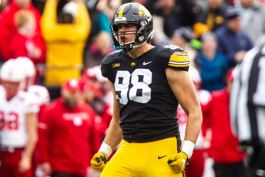 Iowa defensive end Anthony Nelson celebrates a sack against Nebraska in November. The junior had 24 in his Hawkeye career and now is heading to the NFL Scouting Combine to begin a pro career.