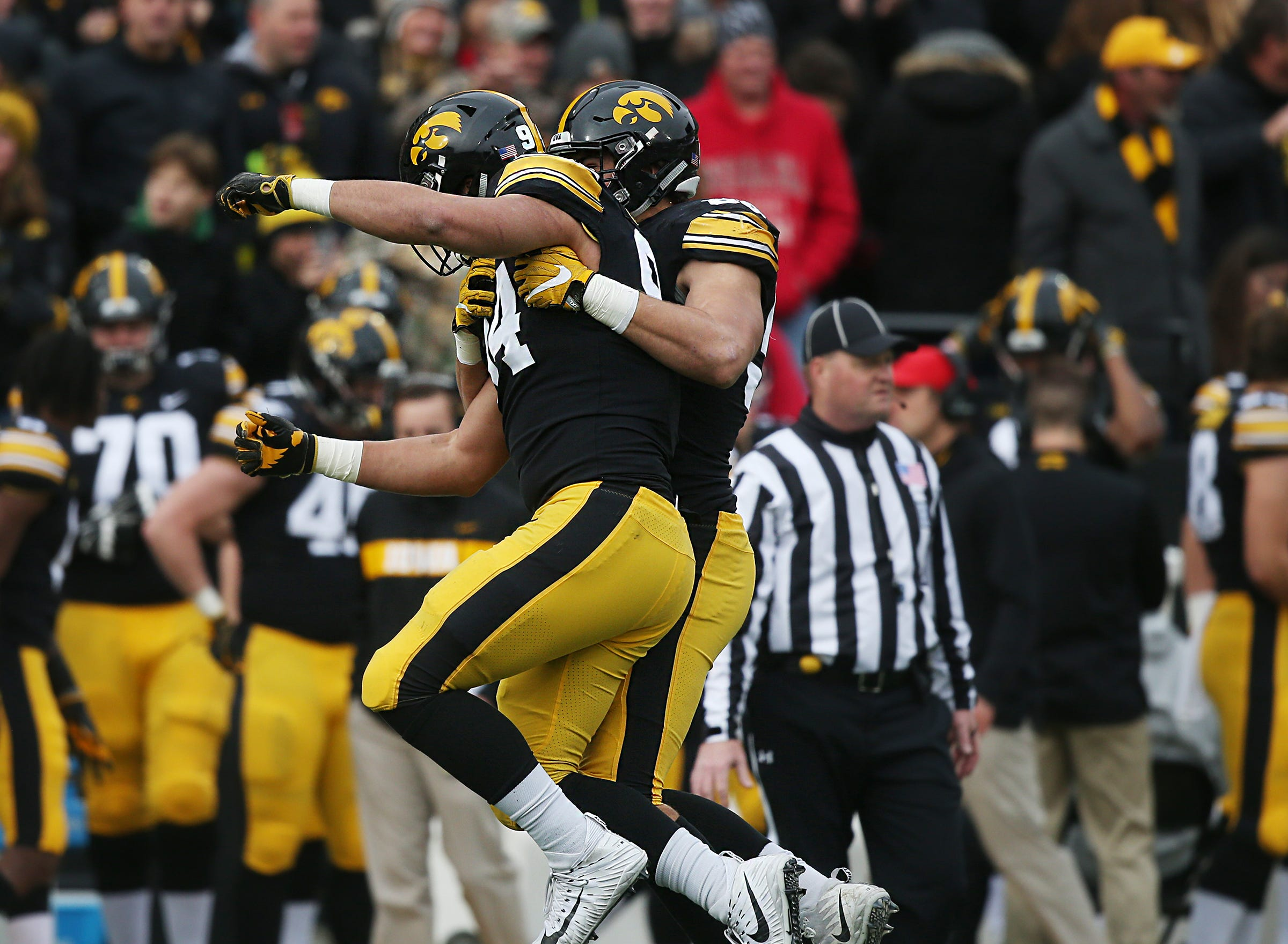 Iowa's A.J. Epenesa and Anthony Nelson celebrate after Nelson sacked Nebraska's quarterback during the senior day match-up between the Iowa Hawkeyes and the Nebraska Cornhuskers on Friday, Nov. 23, 2018, at Kinnick Stadium, in Iowa City.
