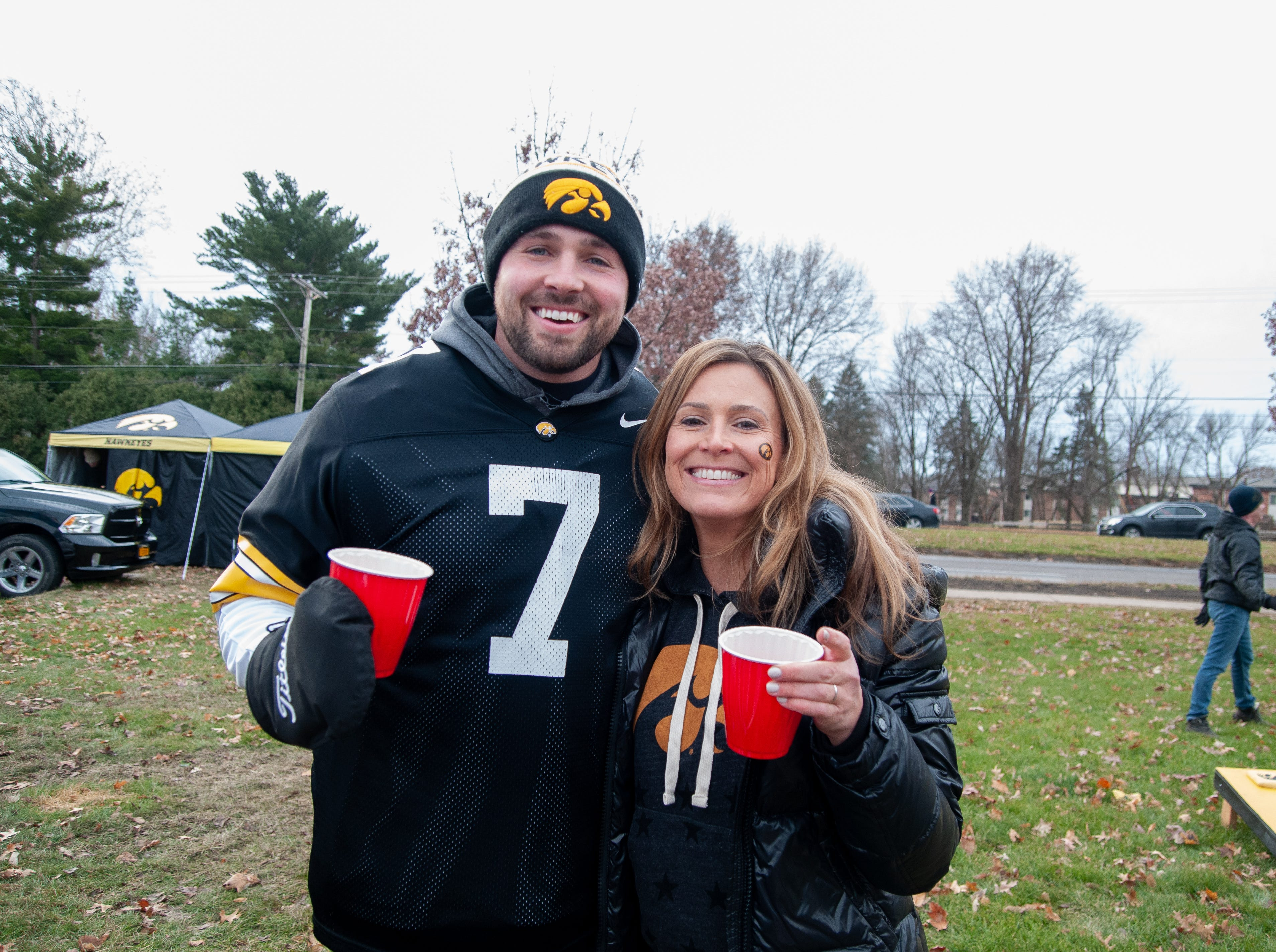 Mike Bisenius, left, and Sarah Mccormick, Friday, Nov. 23, 2018, while tailgating before the Iowa game against Nebraska in Iowa City.