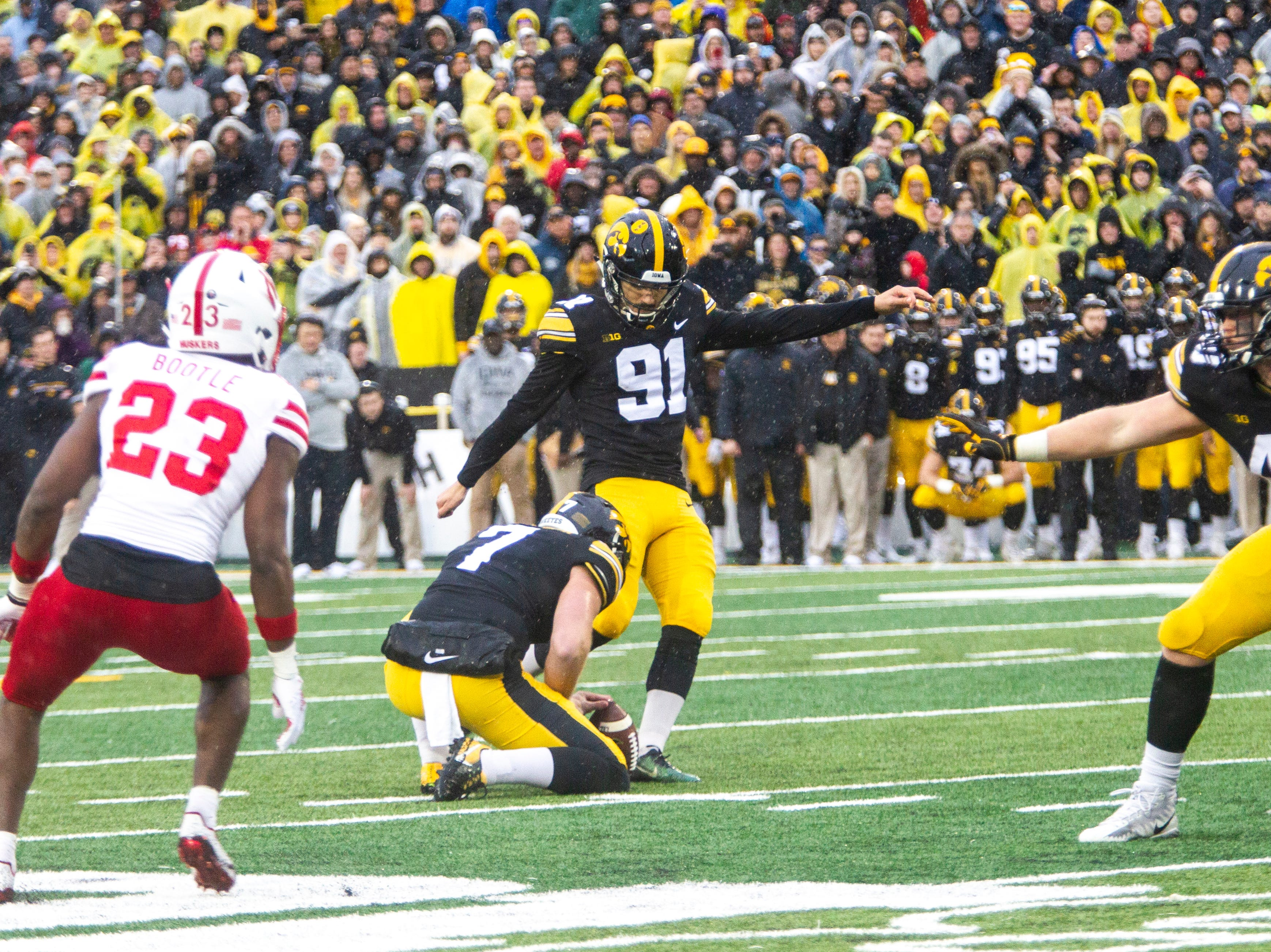 Iowa placekicker Miguel Recinos (91) kicks a game winning field goal during a Big Ten Conference NCAA football game on Friday, Nov. 23, 2018, at Kinnick Stadium in Iowa City.