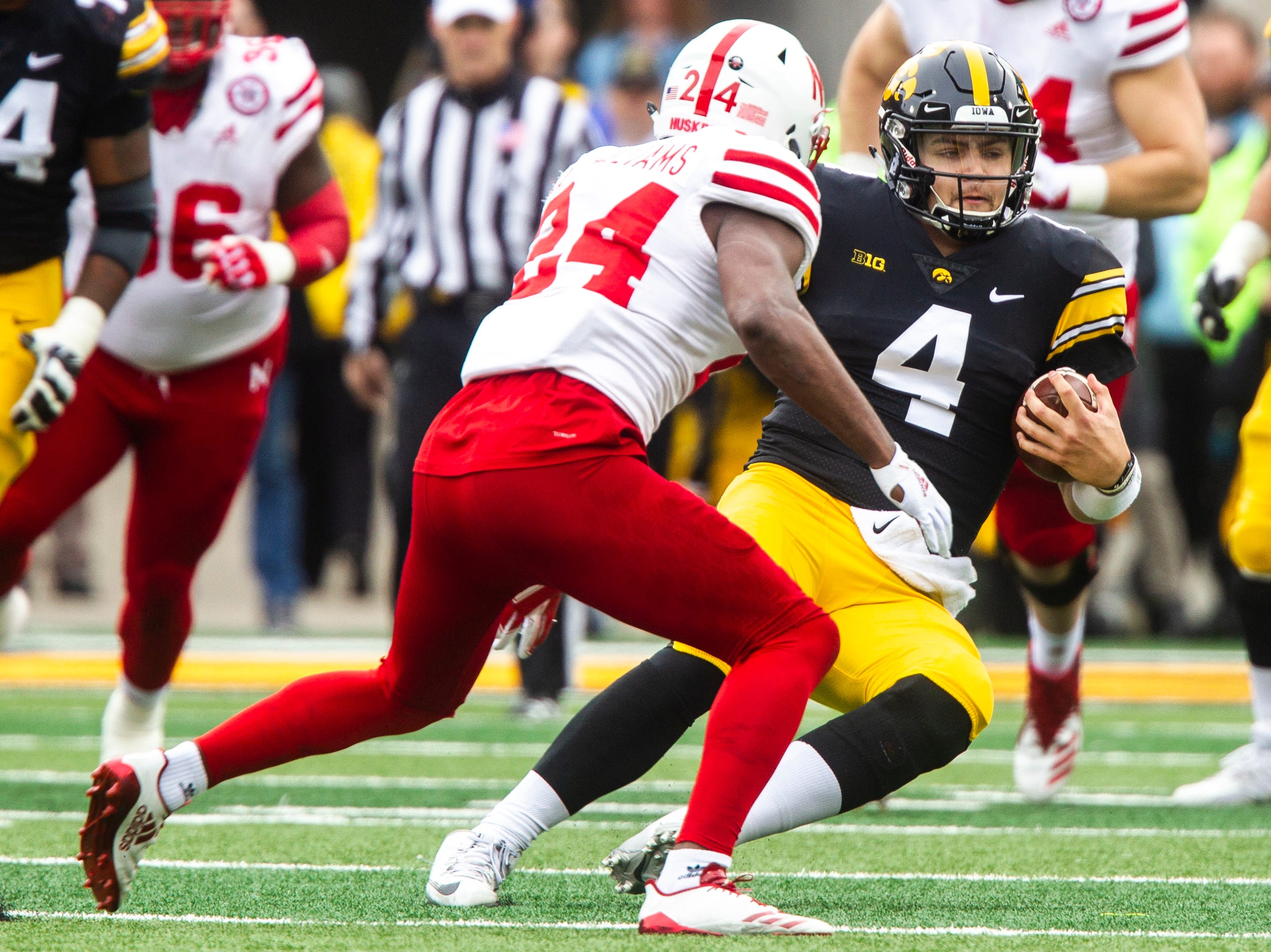Iowa quarterback Nate Stanley (4) slides after rushing for a first down during a Big Ten Conference NCAA football game on Friday, Nov. 23, 2018, at Kinnick Stadium in Iowa City.