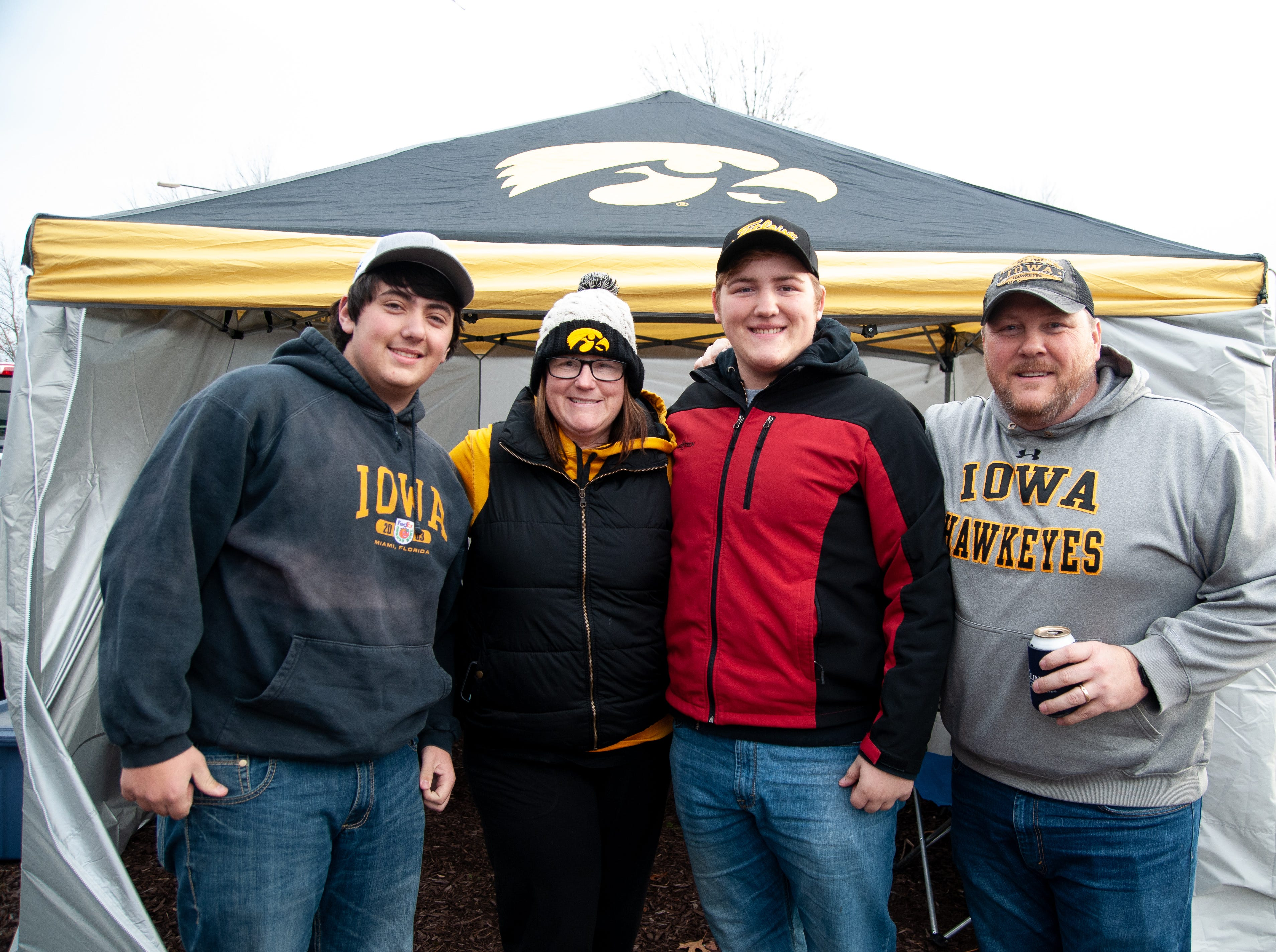 Jacob Engstrom, left, with Mandy, Tyler and Kevin Willey, of Grimes, Friday, Nov. 23, 2018, while tailgating before the Iowa game against Nebraska in Iowa City.