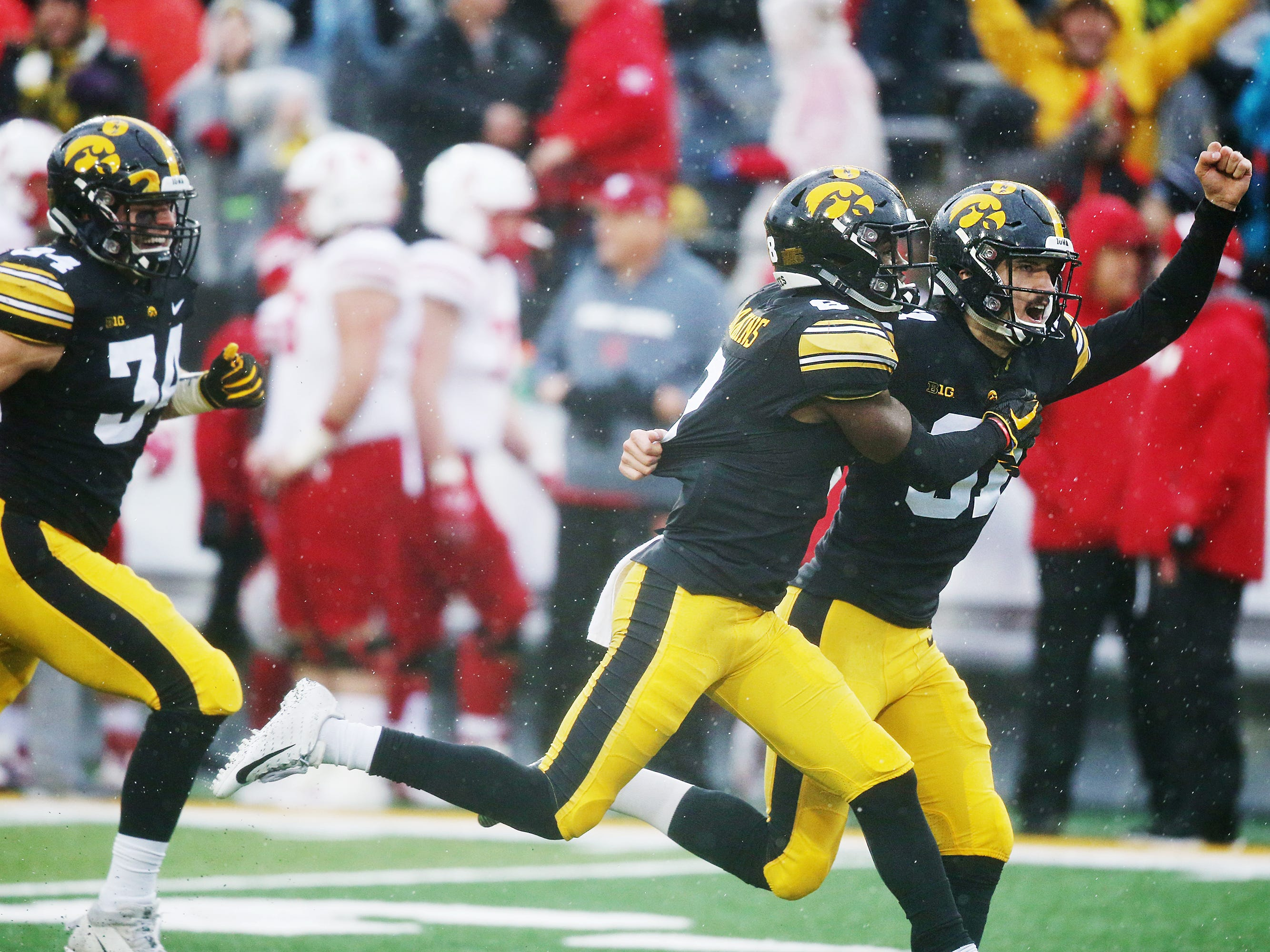 Iowa's kicker Miguel Recinos and Matt Hankins celebrate after Recinos made the game winning kick during the senior day match-up between the Iowa Hawkeyes and the Nebraska Cornhuskers on Friday, Nov. 23, 2018, at Kinnick Stadium, in Iowa City.