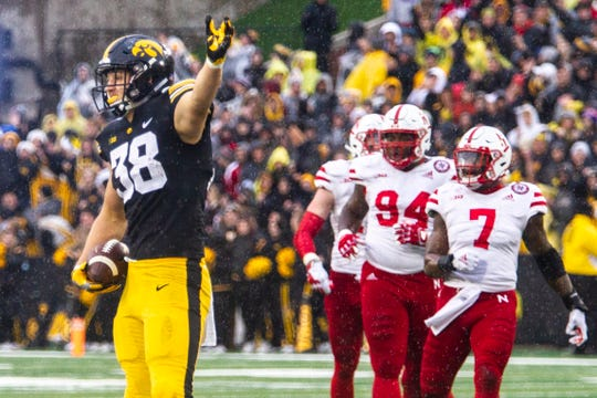 Iowa tight end T.J. Hockenson (38) gestures for a first down after catching a 10-yard pass during a Big Ten Conference NCAA football game on Friday, Nov. 23, 2018, at Kinnick Stadium in Iowa City.
