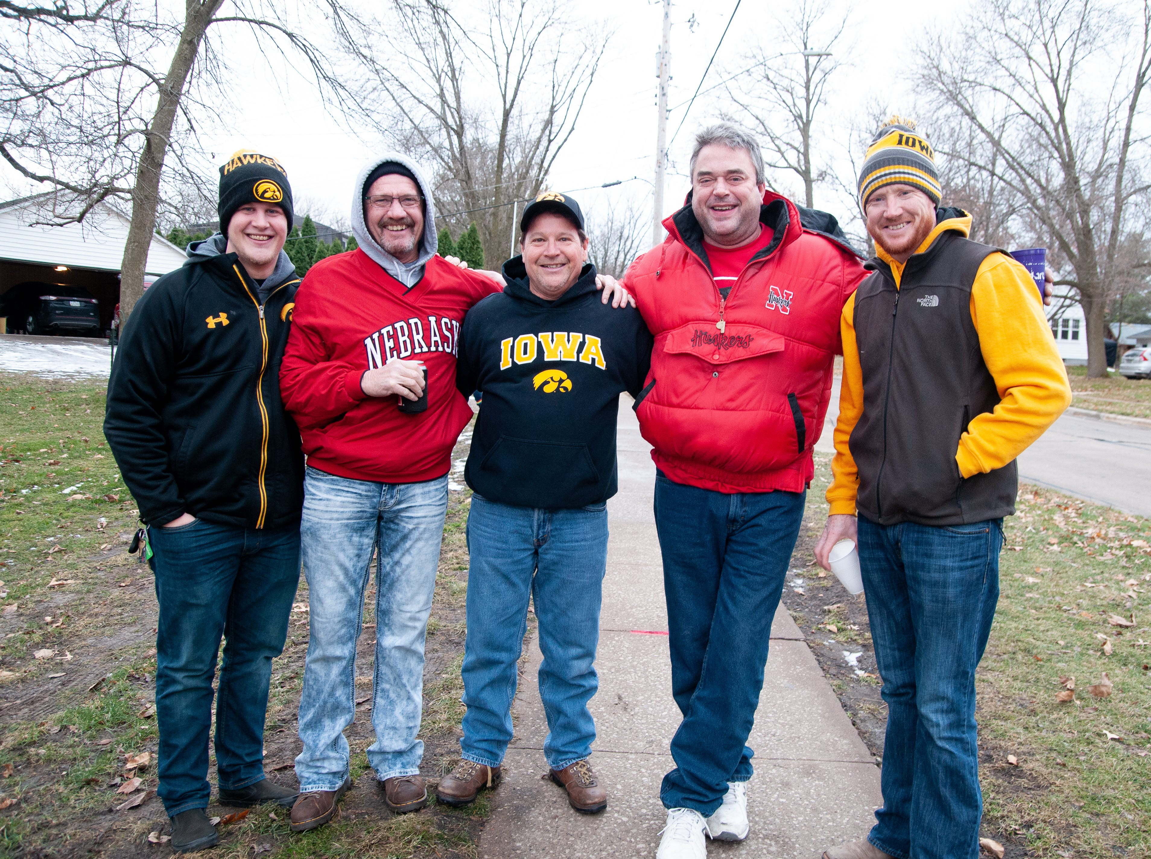 The German family, of Des Moines and Omaha, Friday, Nov. 23, 2018, while tailgating before the Iowa game against Nebraska in Iowa City.