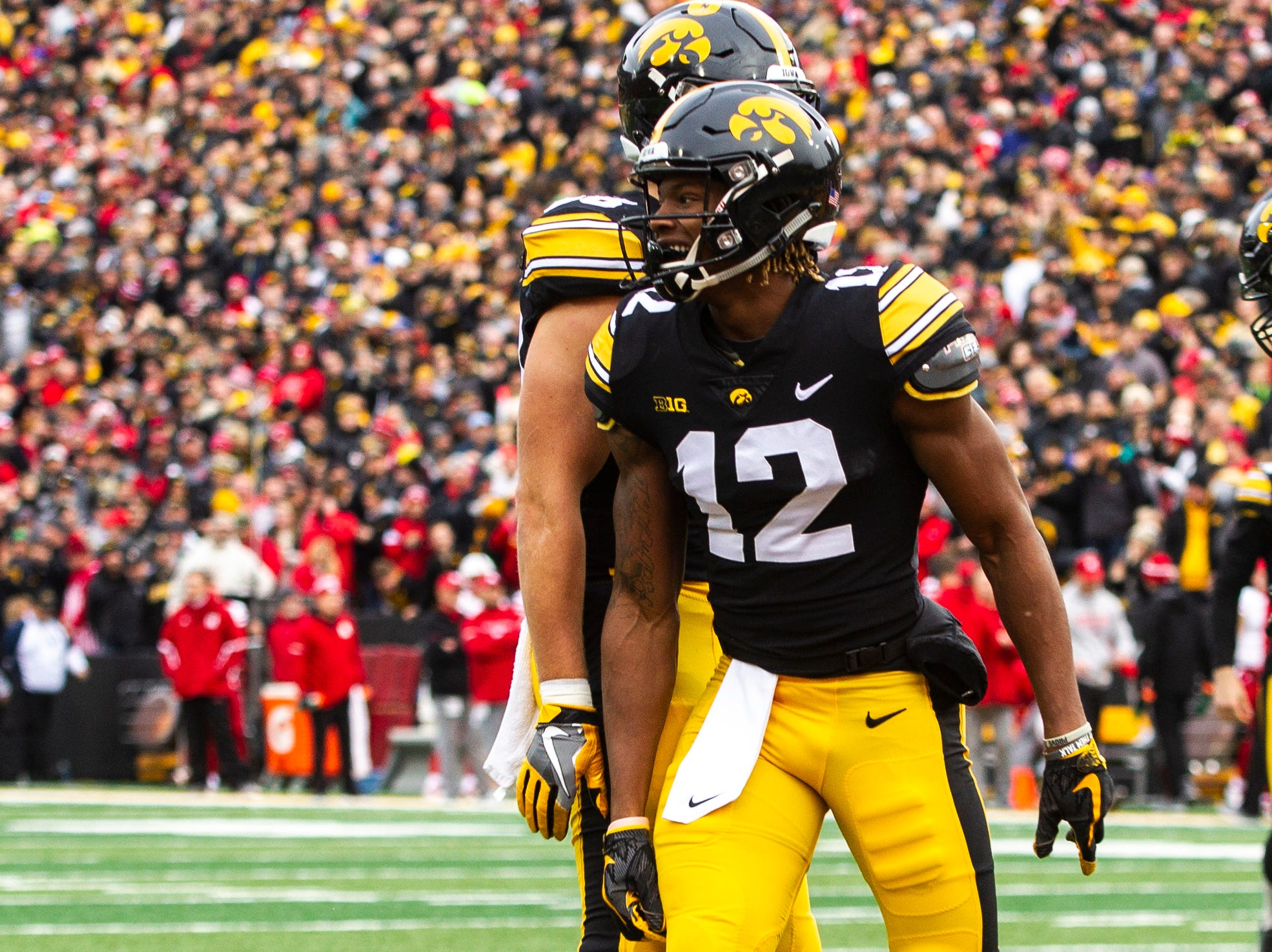 Iowa wide receiver Brandon Smith (12) celebrates after catching a touchdown pass during a Big Ten Conference NCAA football game on Friday, Nov. 23, 2018, at Kinnick Stadium in Iowa City.
