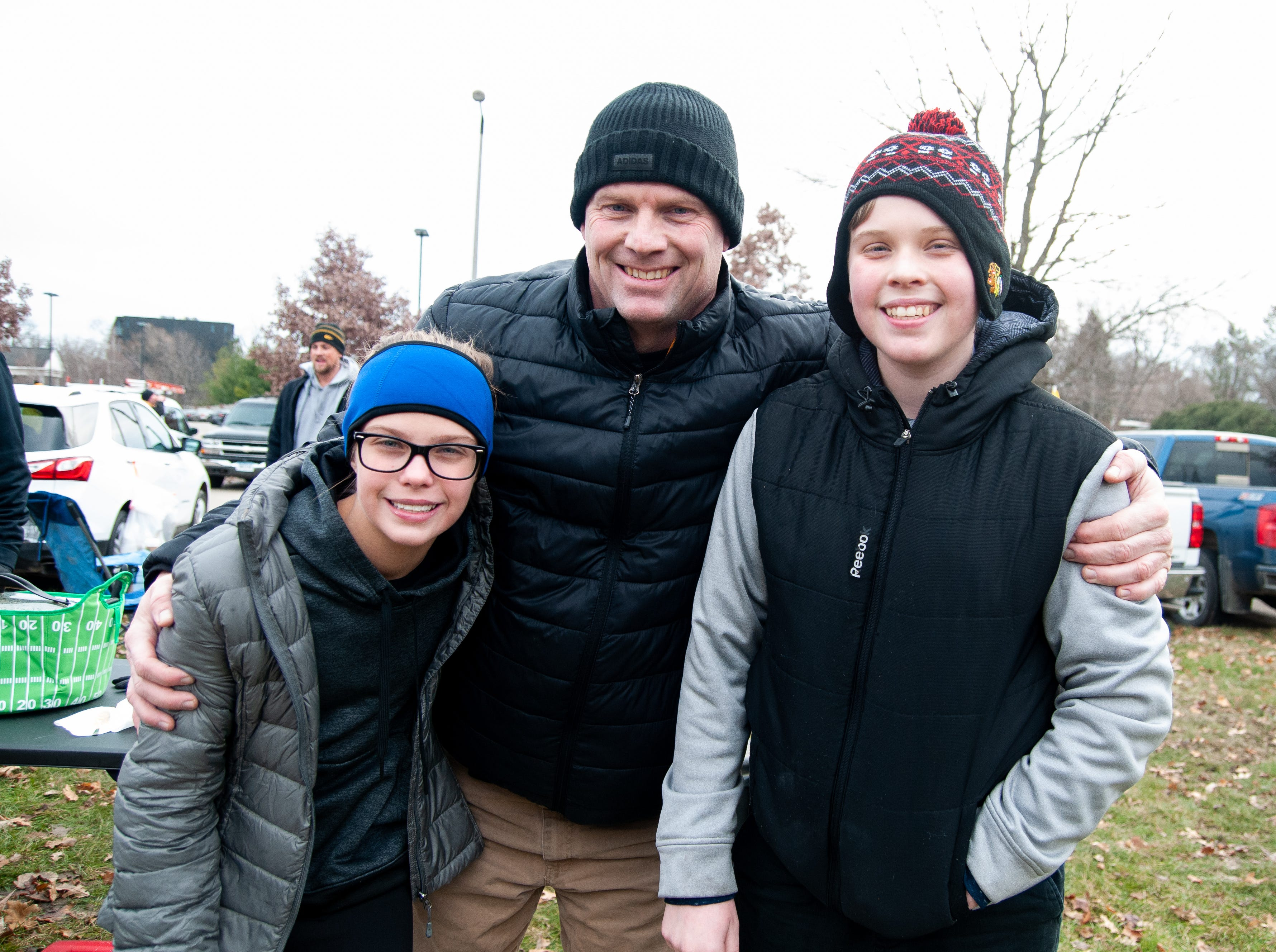 Lydia, left, Tom and Dylan Bisenius, of Chicago, Friday, Nov. 23, 2018, while tailgating before the Iowa game against Nebraska in Iowa City.