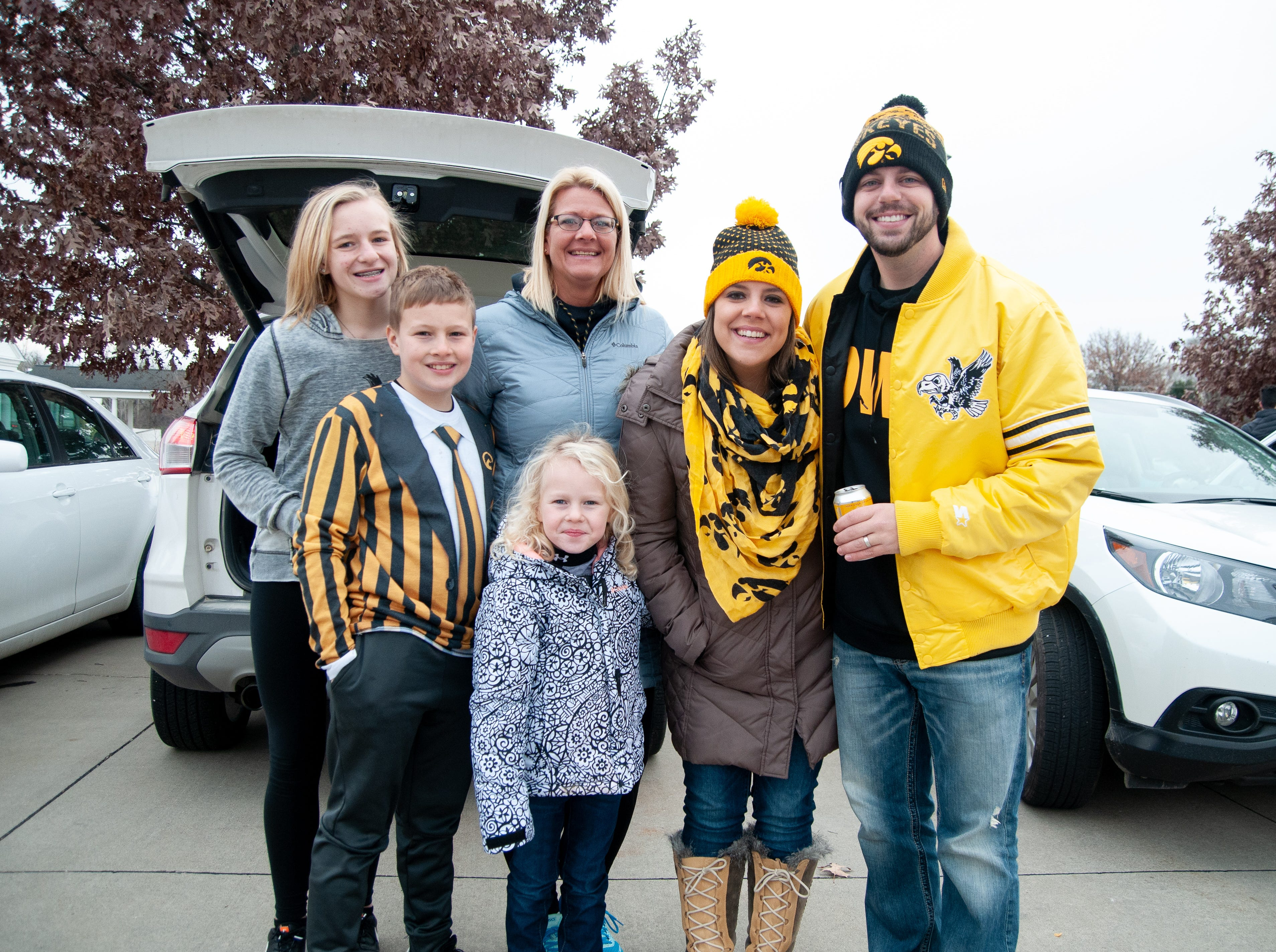 The Duff family, of Mason City, Friday, Nov. 23, 2018, while tailgating before the Iowa game against Nebraska in Iowa City.