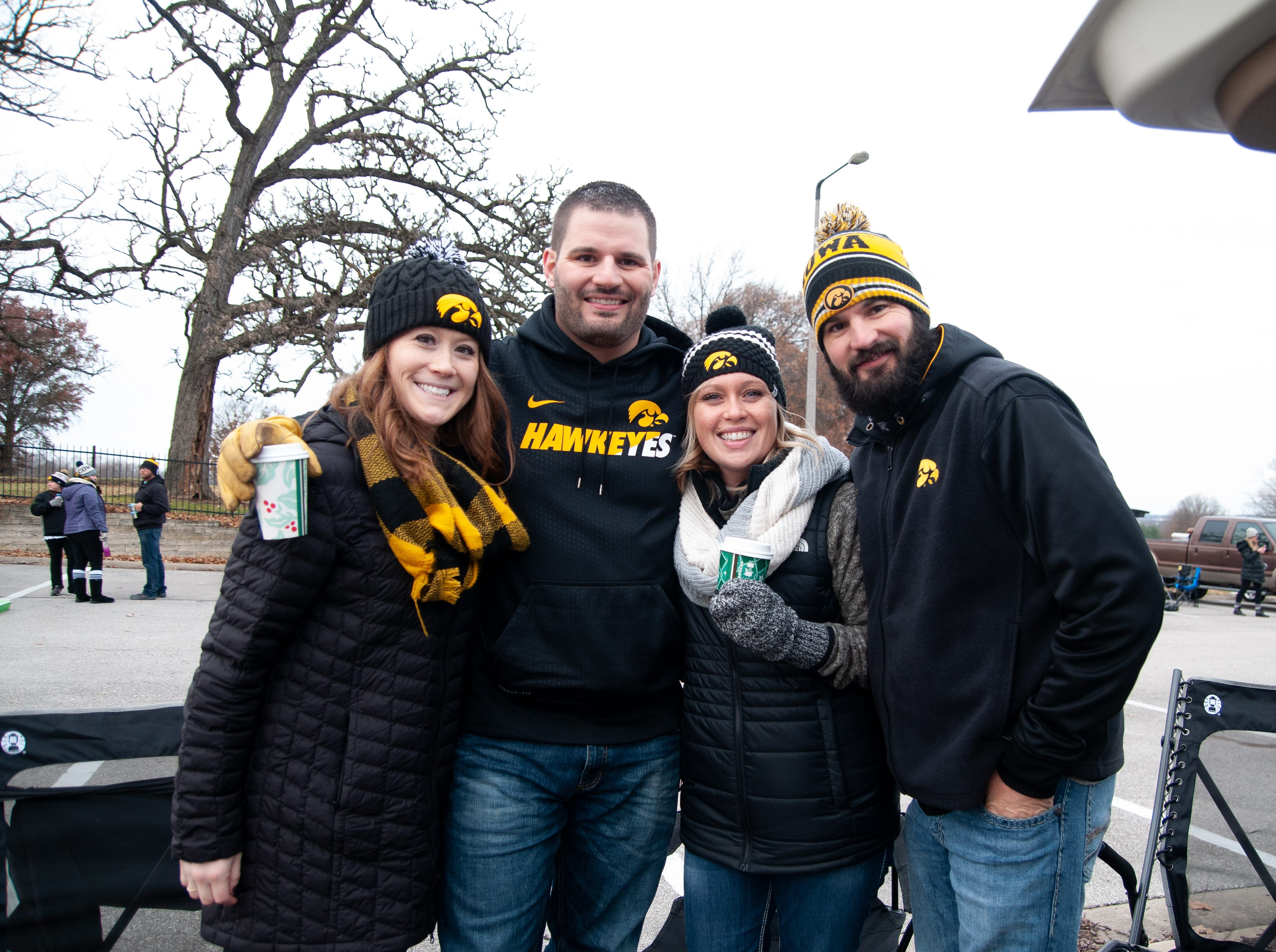 Alexandra Leblanc, Ted Leblanc, Amanda and Kenney Drikx, of Central Iowa, Friday, Nov. 23, 2018, while tailgating before the Iowa game against Nebraska in Iowa City.