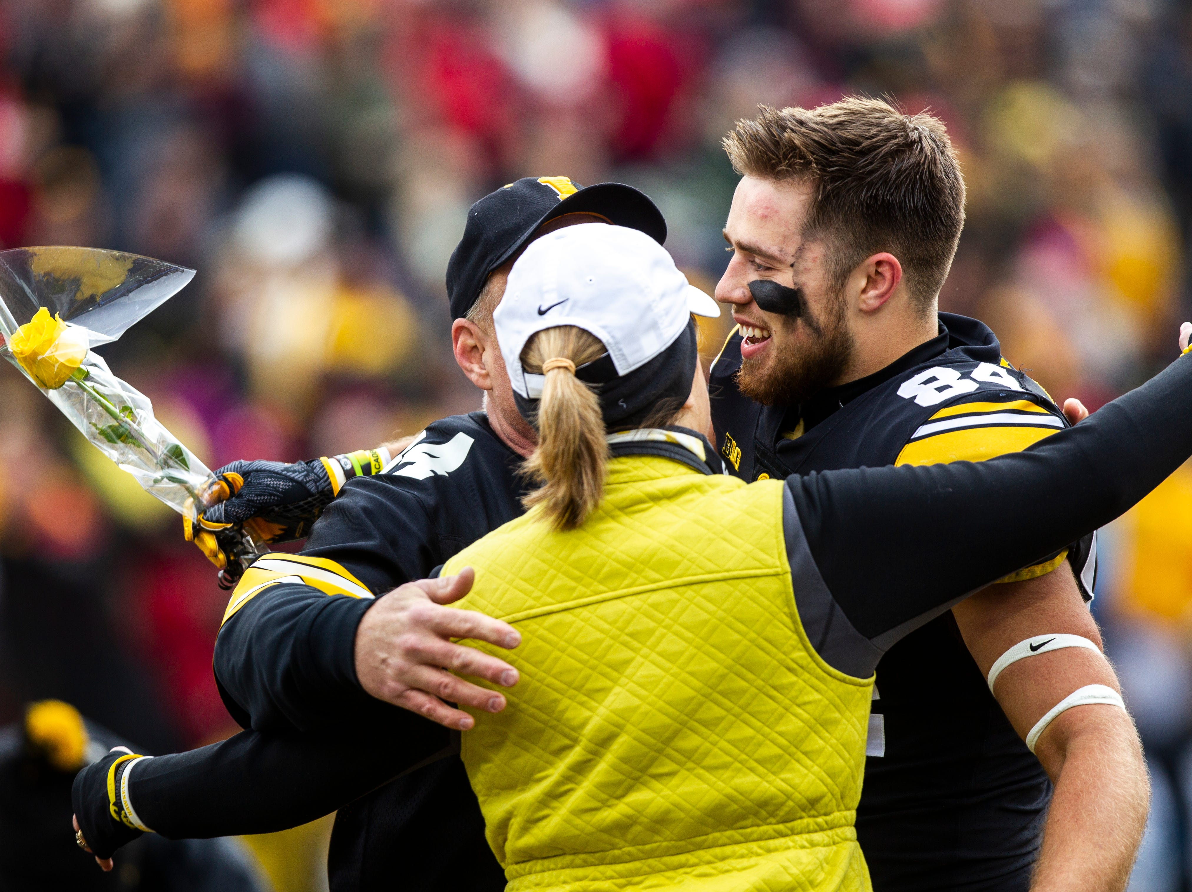 Iowa wide receiver Nick Easley (84) embraces his parents Allison Lemke and John Easley on senior day during a Big Ten Conference NCAA football game on Friday, Nov. 23, 2018, at Kinnick Stadium in Iowa City.
