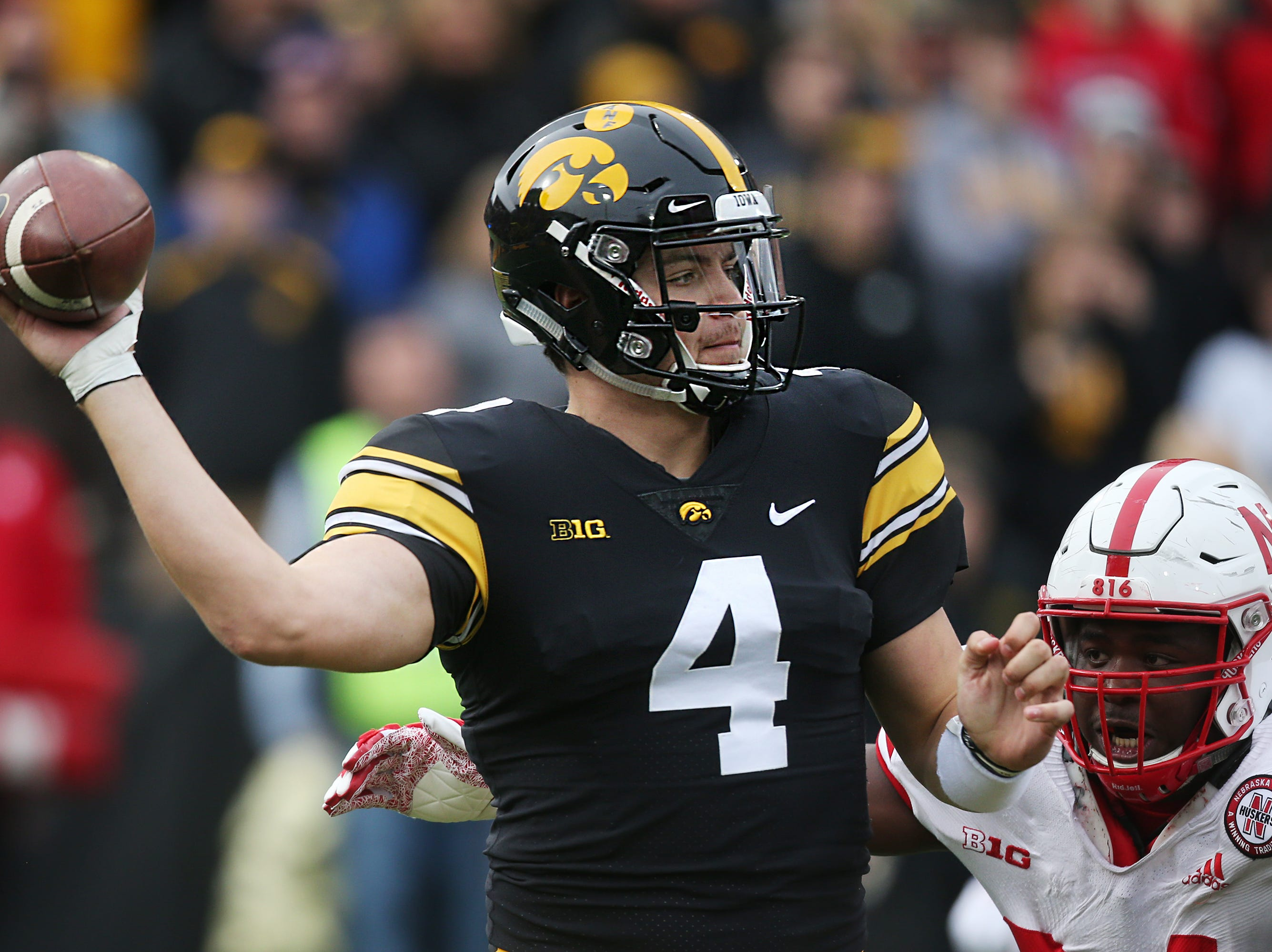 Iowa quarterback Nate Stanley looks for a pass during the senior day match-up between the Iowa Hawkeyes and the Nebraska Cornhuskers on Friday, Nov. 23, 2018, at Kinnick Stadium, in Iowa City.