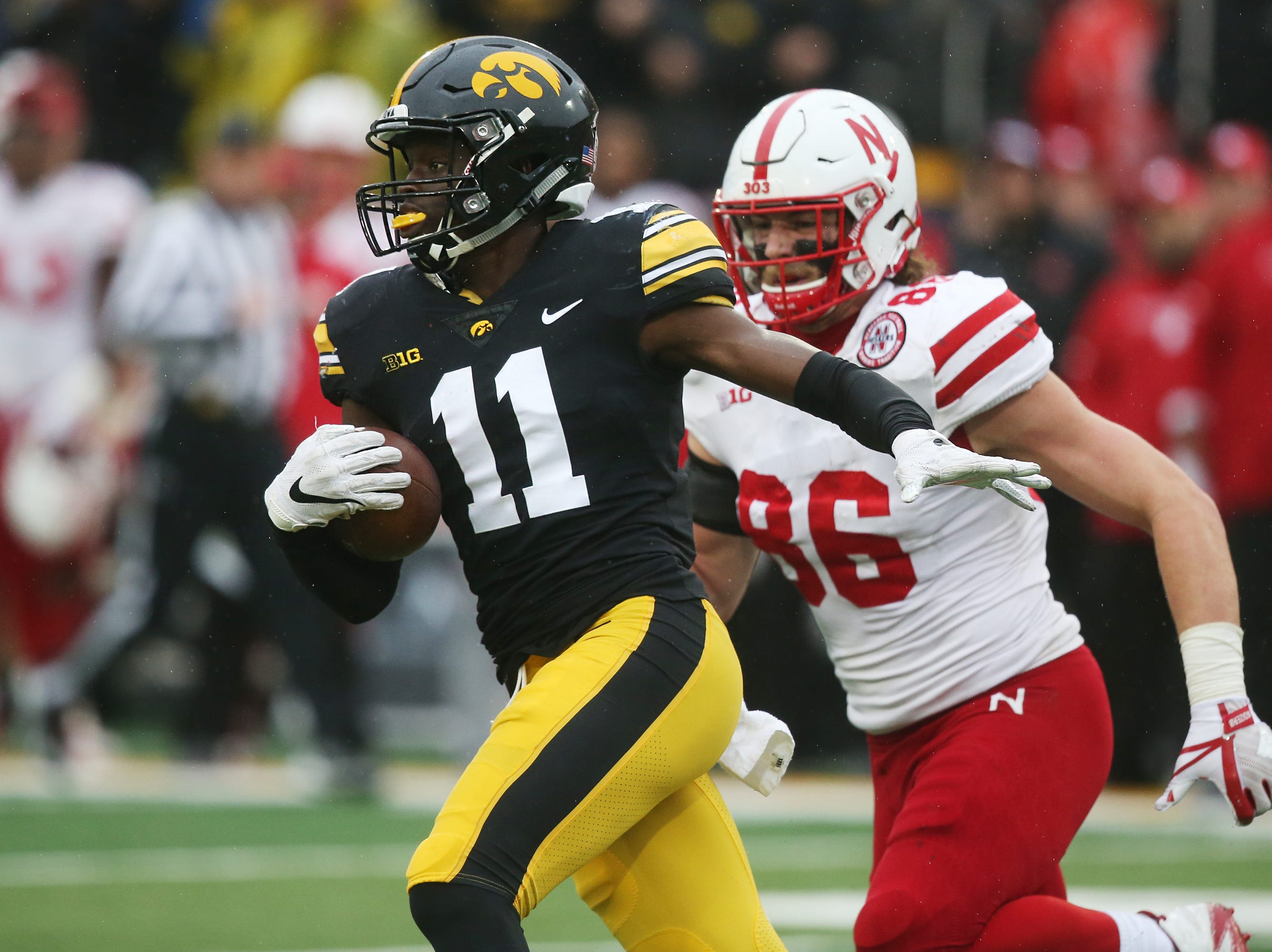 Iowa's Michael Ojemudia picks up an interception during the senior day match-up between the Iowa Hawkeyes and the Nebraska Cornhuskers on Friday, Nov. 23, 2018, at Kinnick Stadium, in Iowa City.