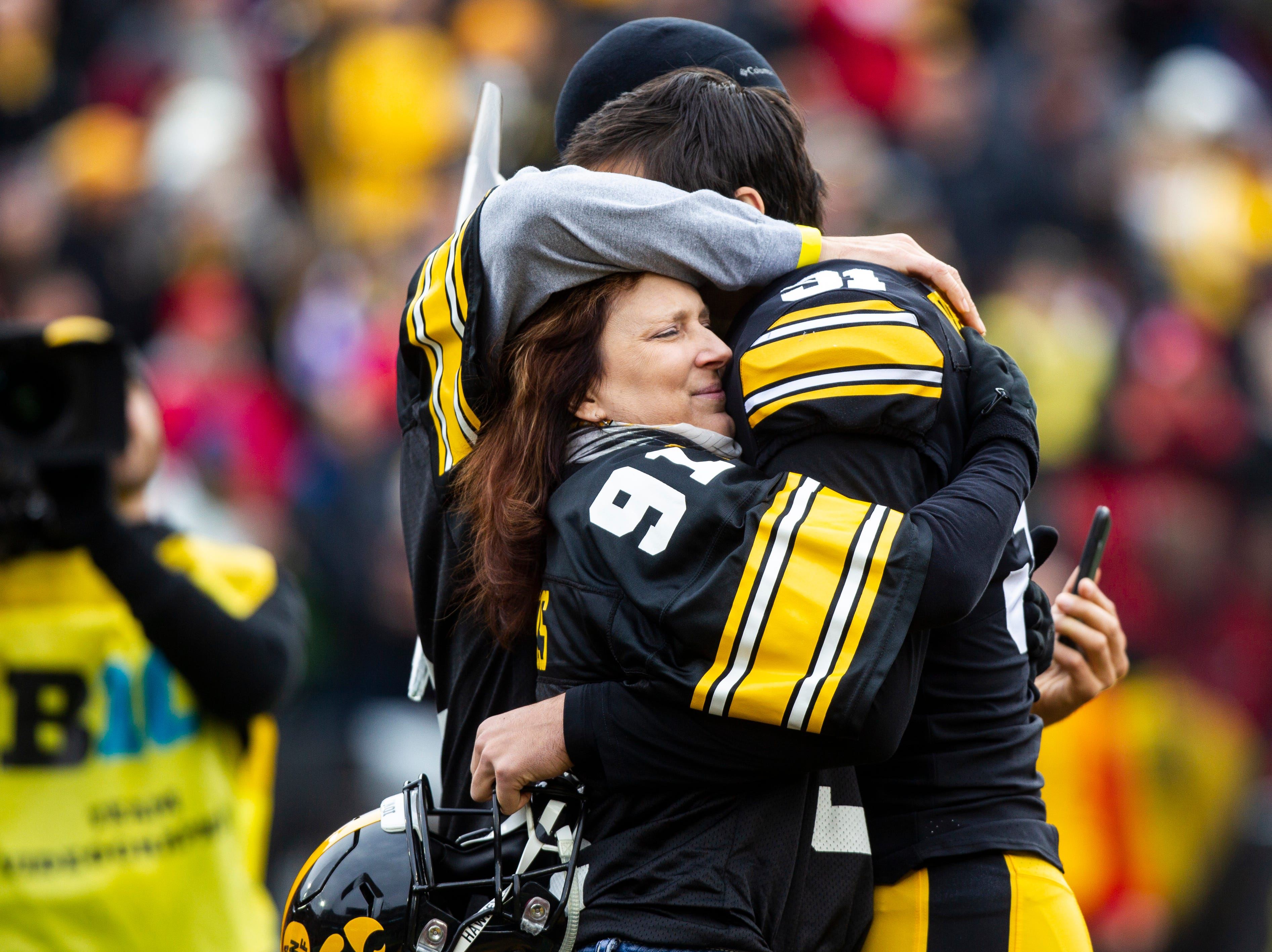 Iowa placekicker Miguel Recinos (91) is embraced by his parents Paula and Rene` on senior day before a Big Ten Conference NCAA football game on Friday, Nov. 23, 2018, at Kinnick Stadium in Iowa City.