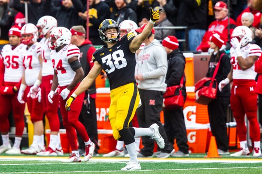 Iowa tight end T.J. Hockenson (38) gestures for a first down following a 25-yard reception during a Big Ten Conference NCAA football game on Friday, Nov. 23, 2018, at Kinnick Stadium in Iowa City.