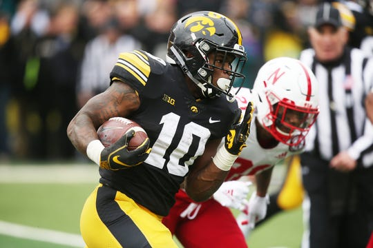 Mekhi Sargent, pictured scoring a touchdown against Nebraska last season, is Iowa's top running back entering 2019. But fellow junior Toren Young figures to get plenty of touches as well. They both vow that the rushing attack will be much improved from 2018, when it ranked 95th in FBS in yards per game.