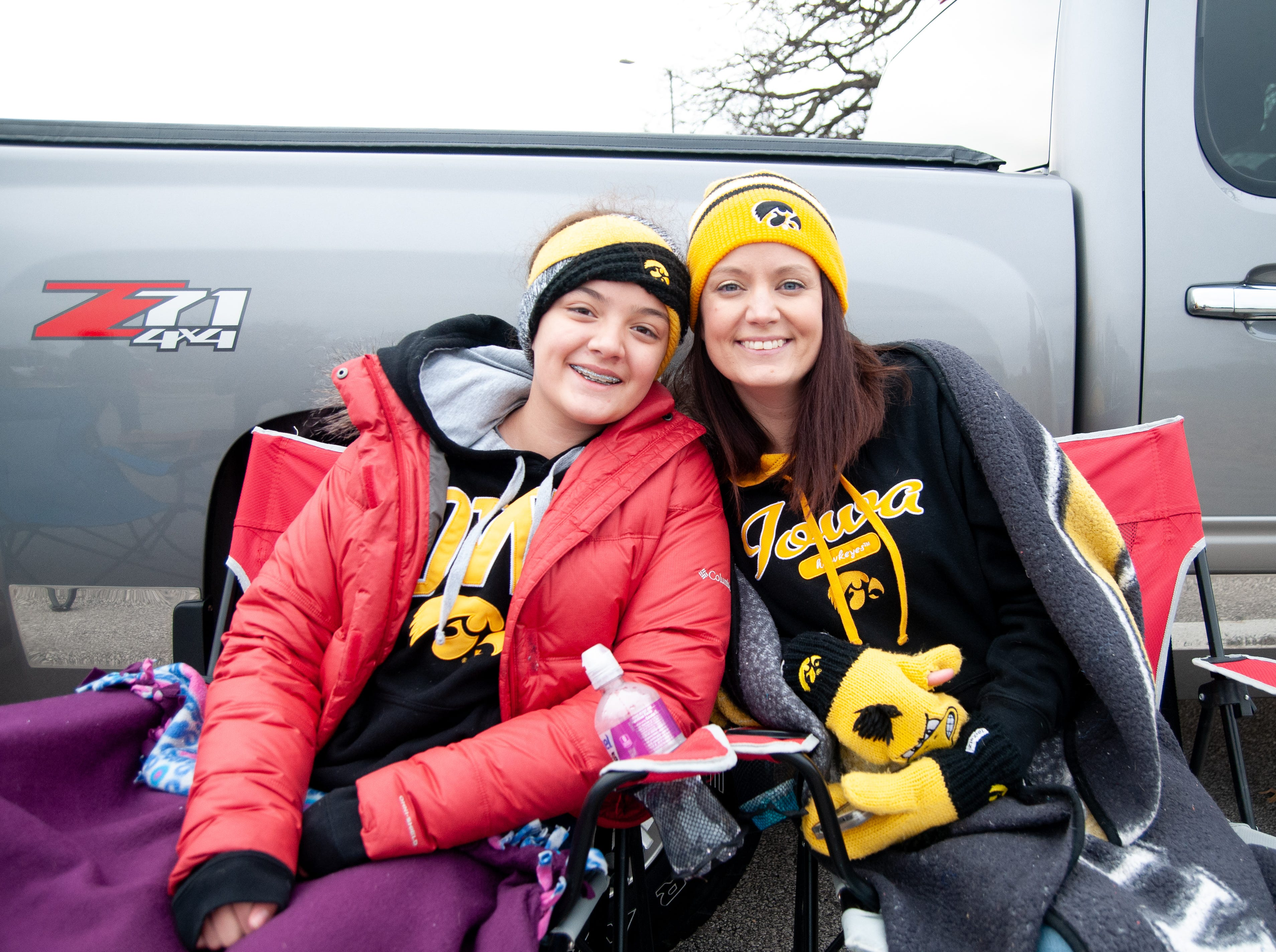 Sonia, left, and Andrea Taylor, of Des Moines, Friday, Nov. 23, 2018, while tailgating before the Iowa game against Nebraska in Iowa City.