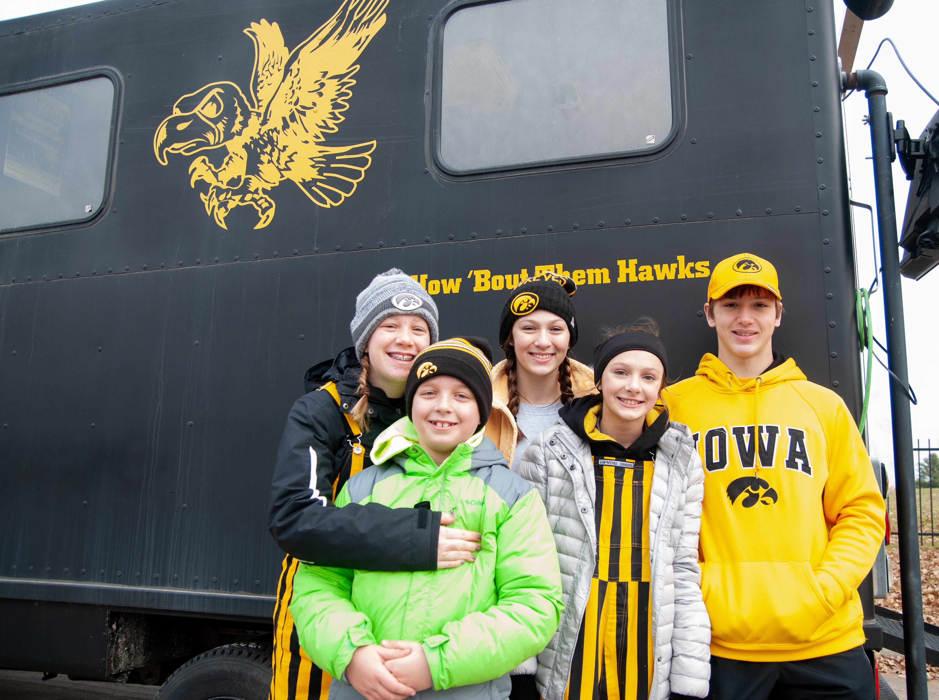 The Wibel, Mcdermott and Pitlik families, of South Dakota and Mount Vernon, Friday, Nov. 23, 2018, while tailgating before the Iowa game against Nebraska in Iowa City.