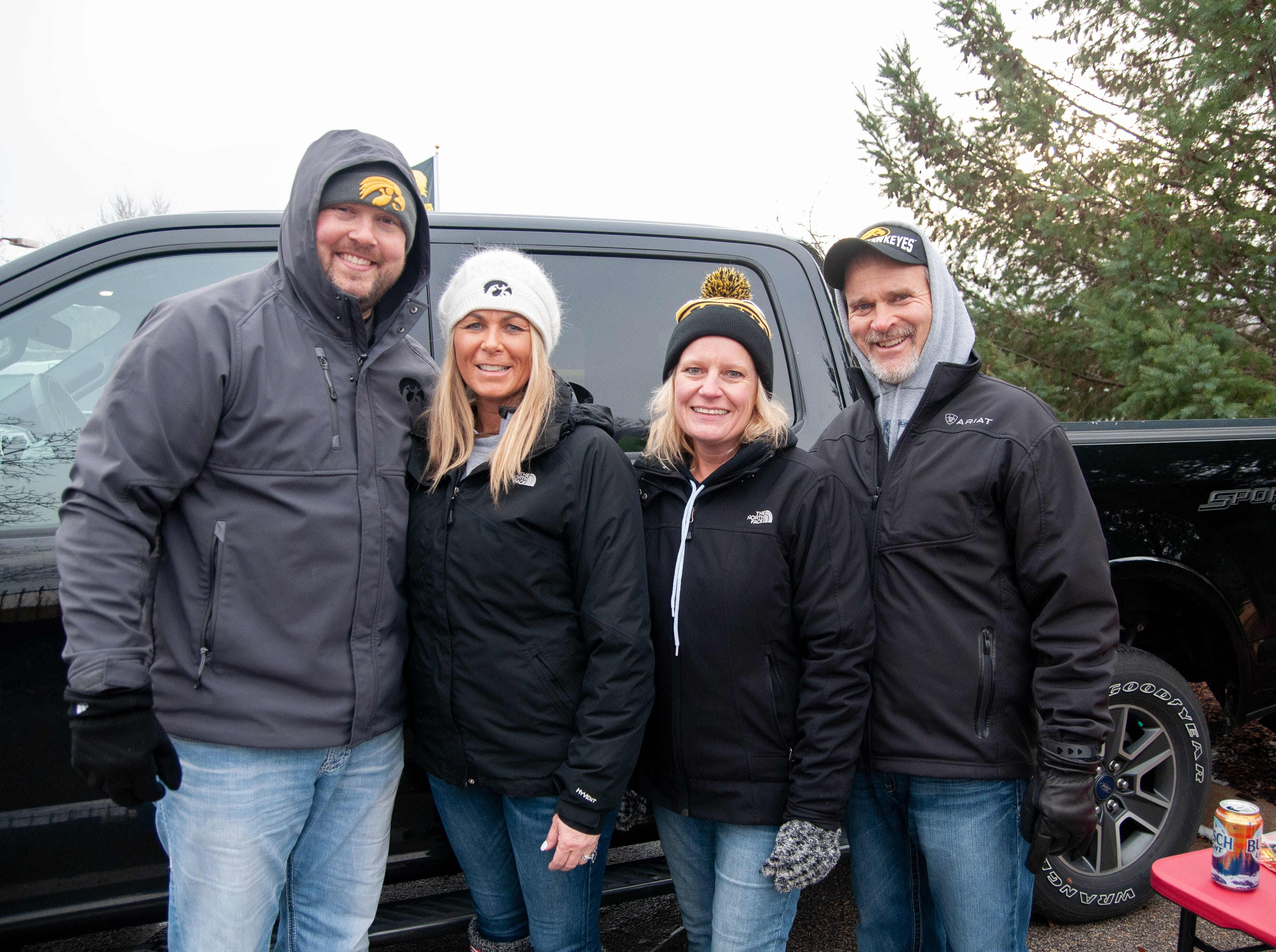 Andy, left, and Tara Quirk, with Julie and Russ Tucker, of Grand Junction, Friday, Nov. 23, 2018, while tailgating before the Iowa game against Nebraska in Iowa City.