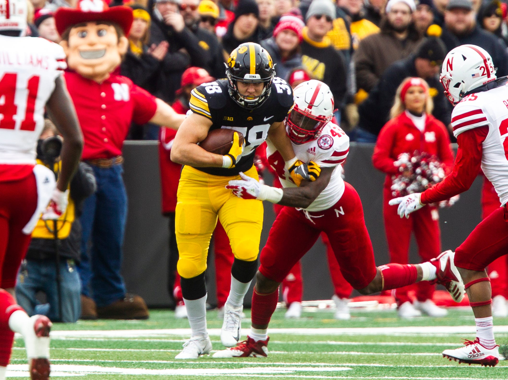 Iowa tight end T.J. Hockenson (38) gets tackled by Nebraska's Tyrin Ferguson (43) during a Big Ten Conference NCAA football game on Friday, Nov. 23, 2018, at Kinnick Stadium in Iowa City.
