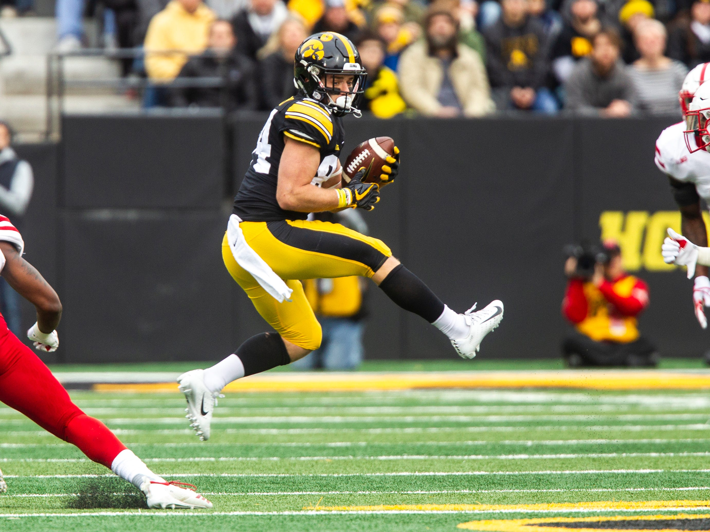 Iowa wide receiver Nick Easley (84) makes a jumping catch during a Big Ten Conference NCAA football game on Friday, Nov. 23, 2018, at Kinnick Stadium in Iowa City.