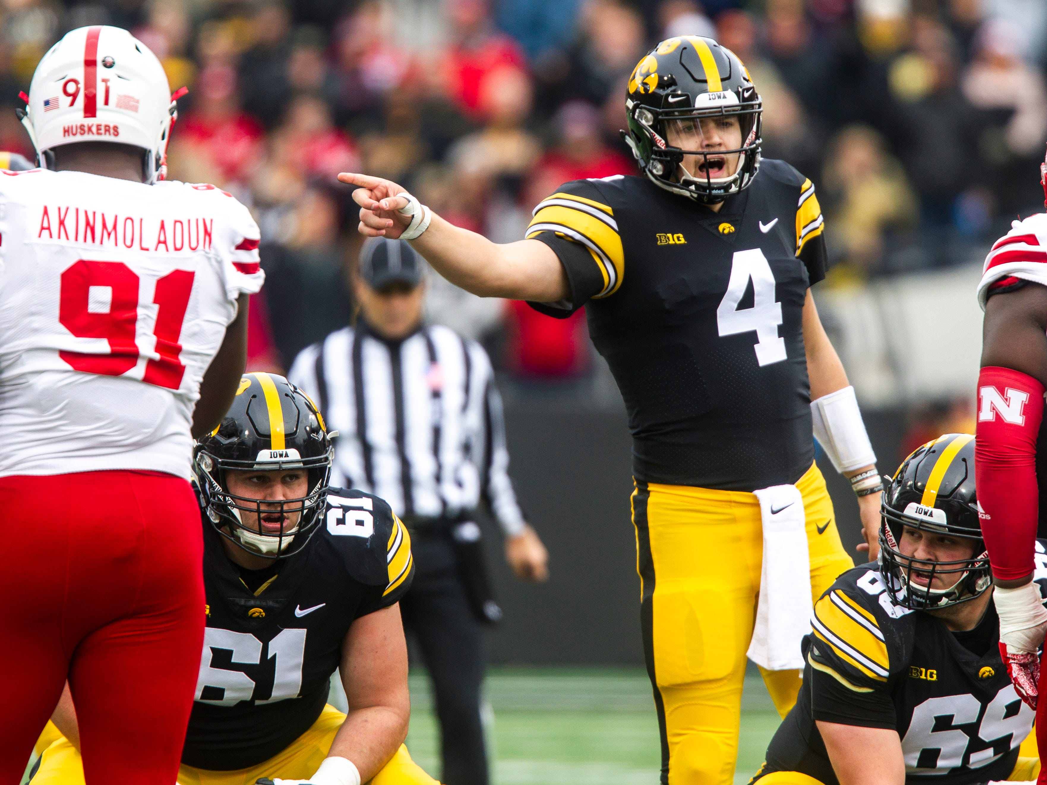 Iowa quarterback Nate Stanley (4) gestures at the line during a Big Ten Conference NCAA football game on Friday, Nov. 23, 2018, at Kinnick Stadium in Iowa City.