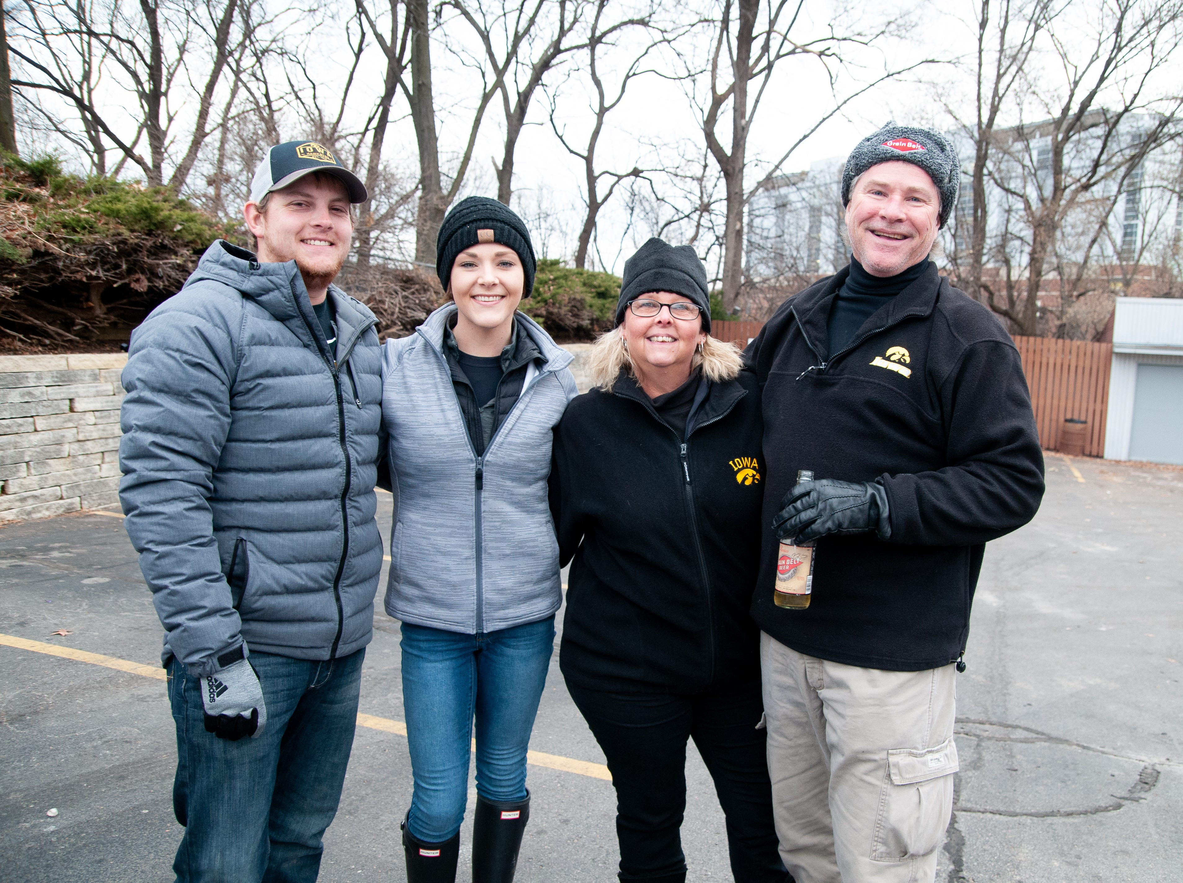 Kurt and Bernese Sorenson, left, with Lisa and Bud Wrage, of Gladbrook, Friday, Nov. 23, 2018, while tailgating before the Iowa game against Nebraska in Iowa City.