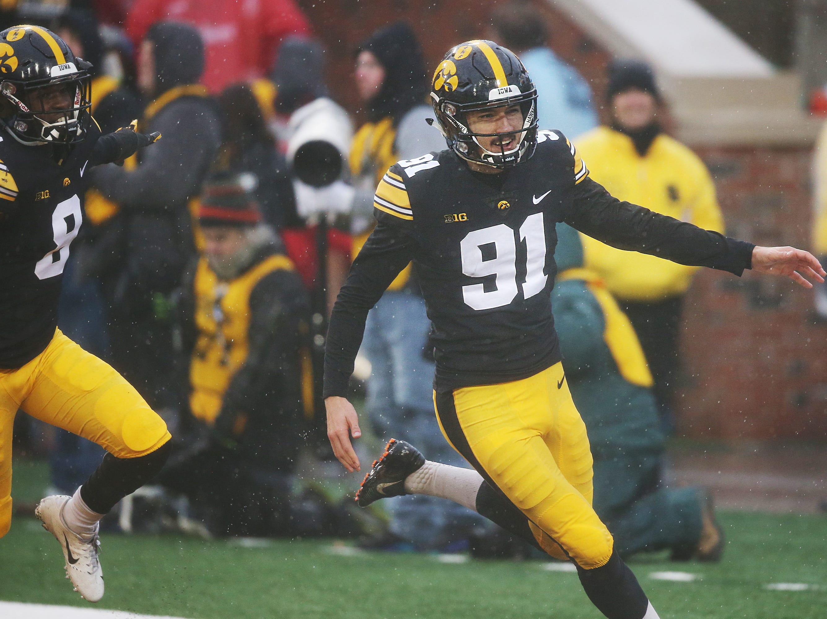 Iowa's kicker Miguel Recinos celebrates after making the game winning kick during the senior day match-up between the Iowa Hawkeyes and the Nebraska Cornhuskers on Friday, Nov. 23, 2018, at Kinnick Stadium, in Iowa City.