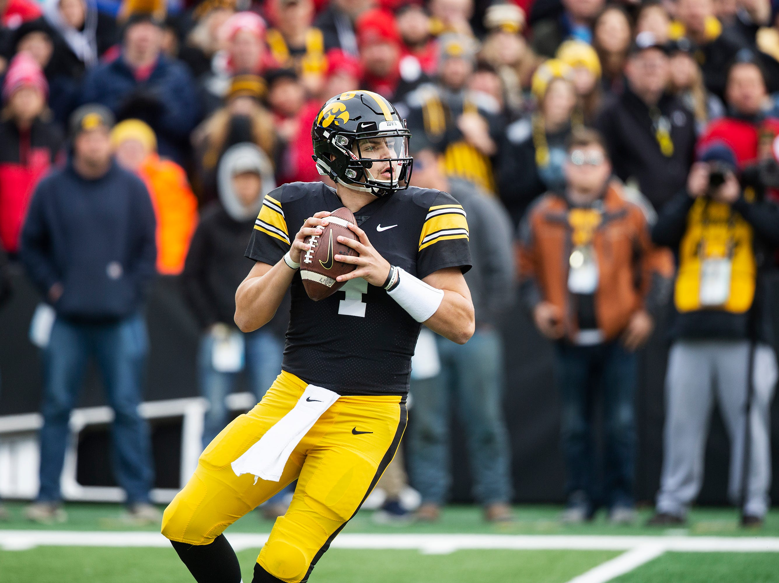 Iowa quarterback Nate Stanley passes the ball during the senior day match-up between the Iowa Hawkeyes and the Nebraska Cornhuskers on Friday, Nov. 23, 2018, at Kinnick Stadium, in Iowa City.