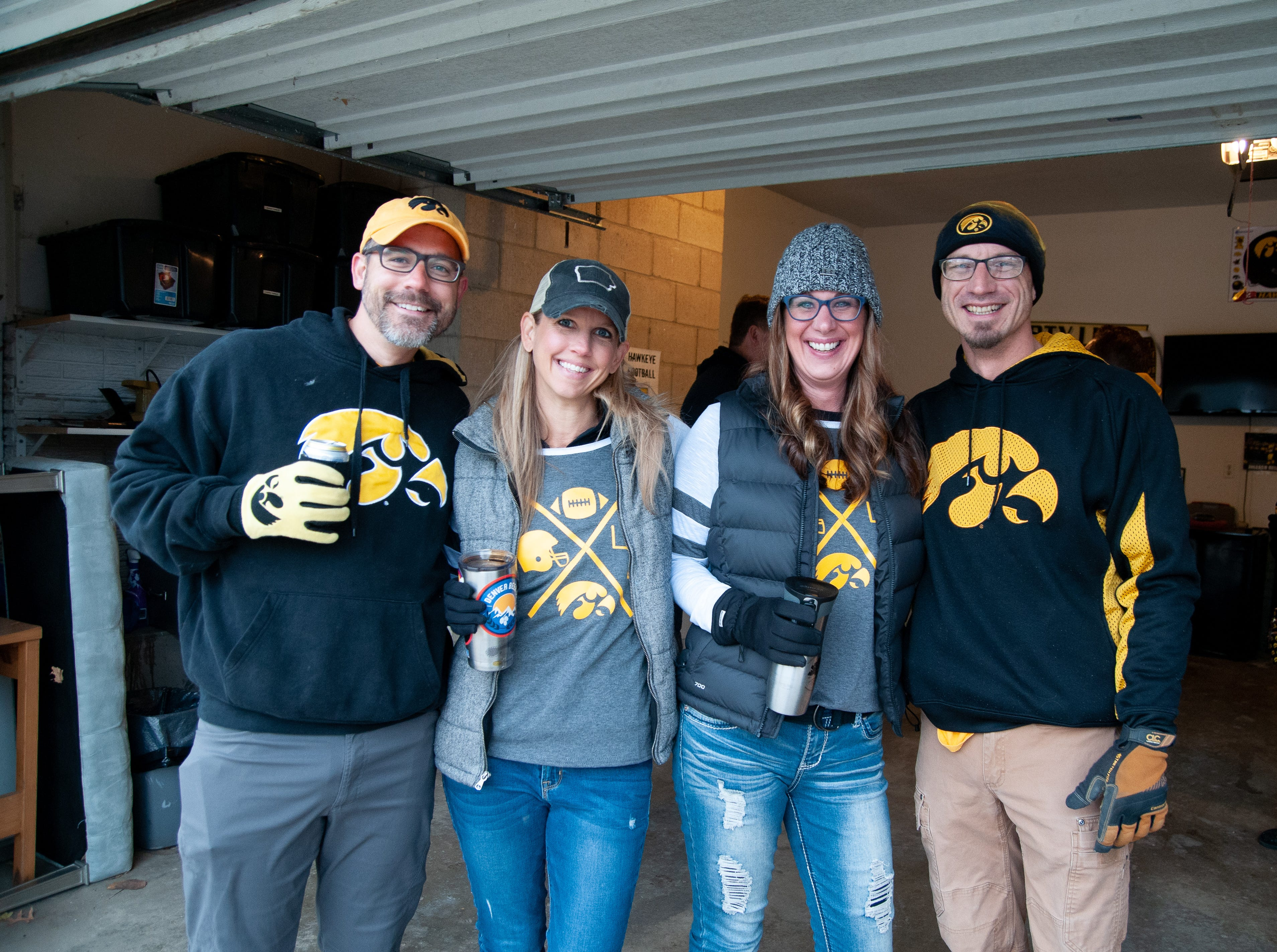 Casey, left, Jodi, Jamie and Cyle Carlson, of St. Louis and Sanborn, Friday, Nov. 23, 2018, while tailgating before the Iowa game against Nebraska in Iowa City.