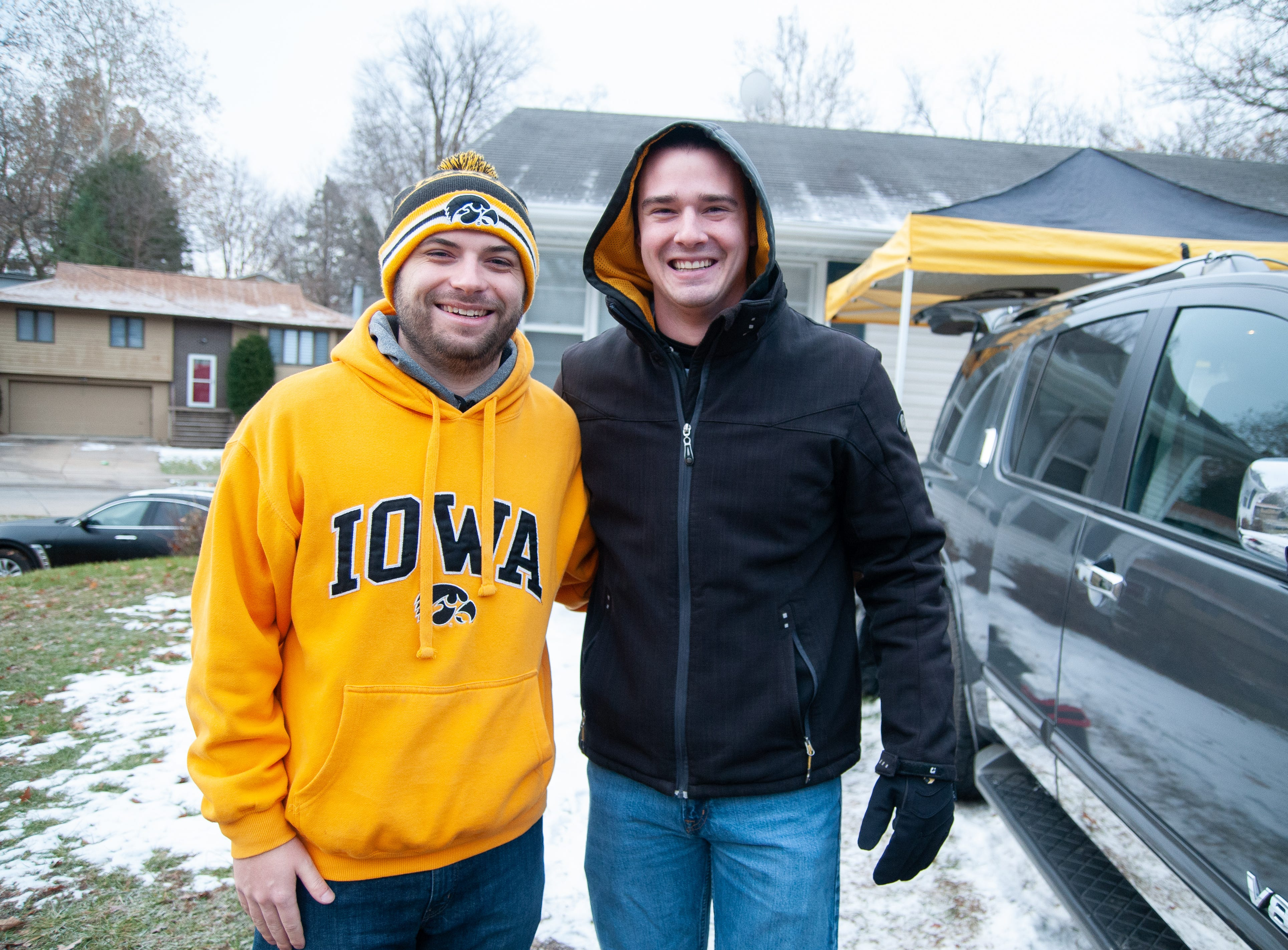 Zach Henningsen, left, and Evan Walsh, of Iowa City and eastern Iowa, Friday, Nov. 23, 2018, while tailgating before the Iowa game against Nebraska in Iowa City.