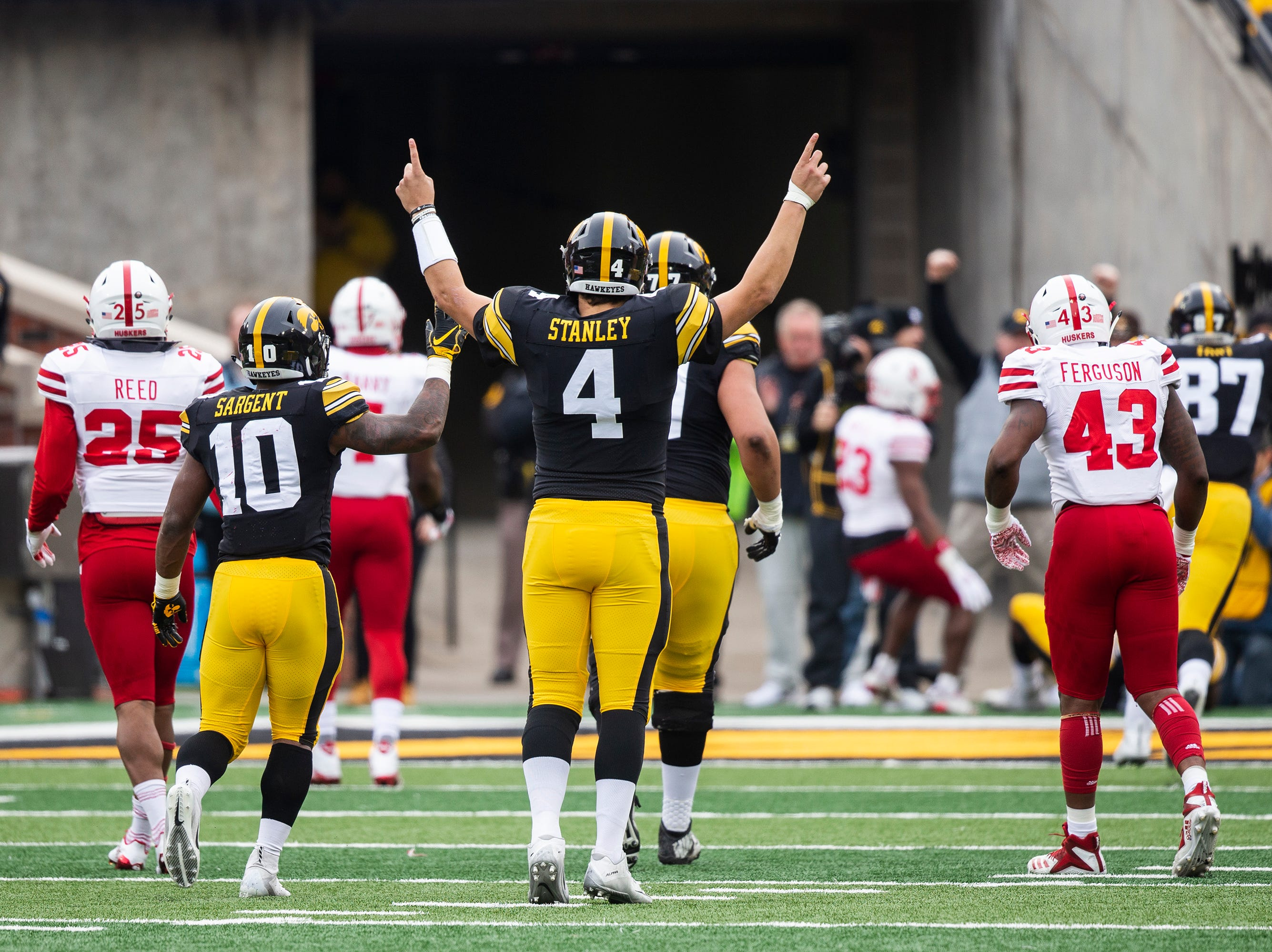 Iowa quarterback Nate Stanley celebrates after making a touchdown scoring pass during the senior day match-up between the Iowa Hawkeyes and the Nebraska Cornhuskers on Friday, Nov. 23, 2018, at Kinnick Stadium, in Iowa City.