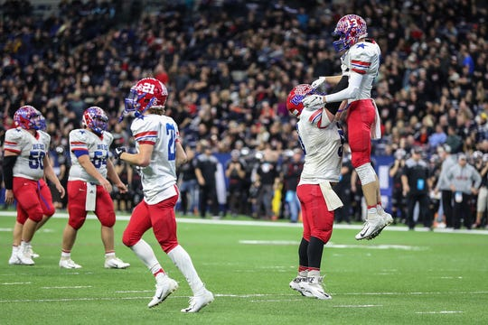 The Western Boone Stars celebrate a touchdown by Logan Benson (13) late in the fourth quarter, locking in their win over Eatsbrook in IHSAA Class 2A state finals at Lucas Oil Stadium in Indianapolis, Friday, Nov. 23, 2018. Western Boone won the championship, 34-20.