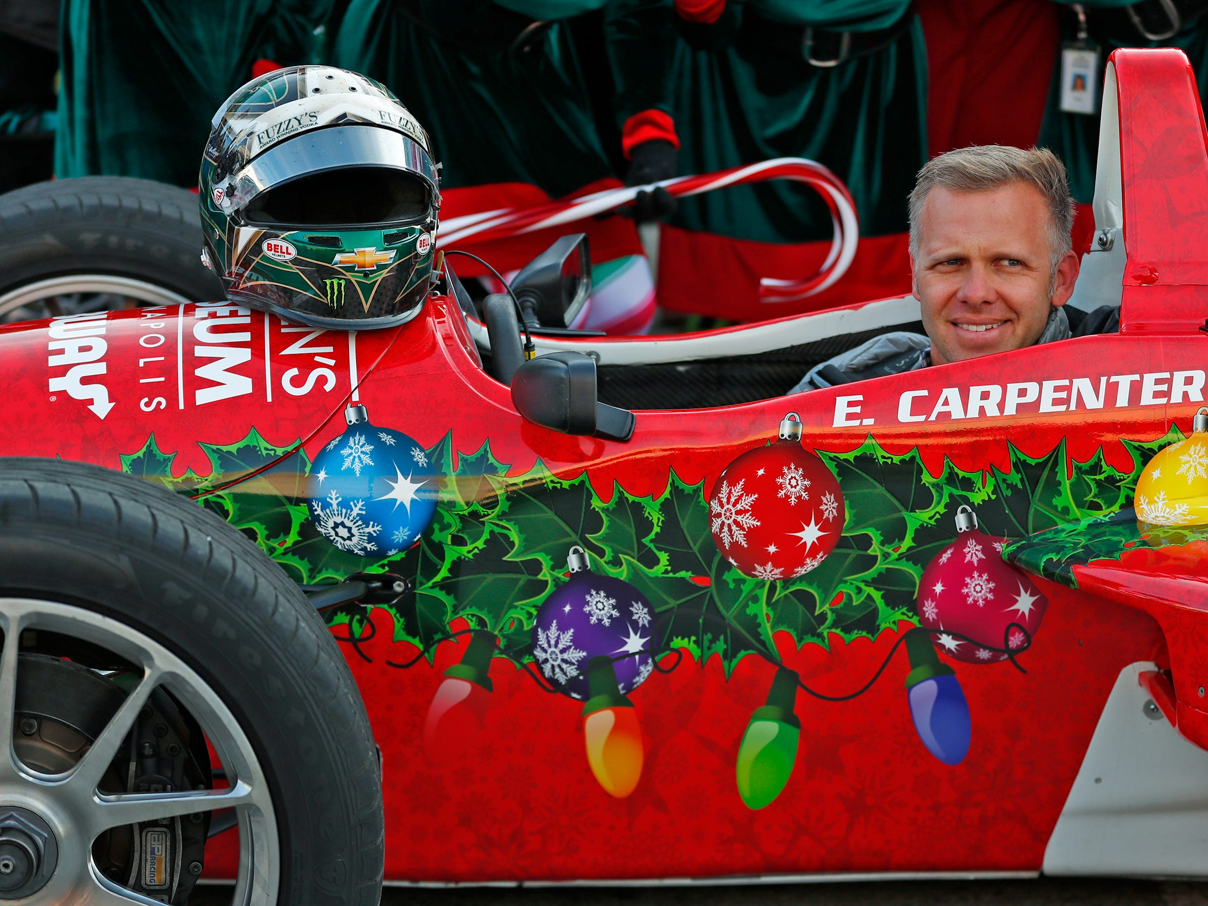 IndyCar driver Ed Carpenter smiles after driving Santa to the Children's Museum of Indianapolis in an IndyCar, Friday, Nov. 23, 2018.