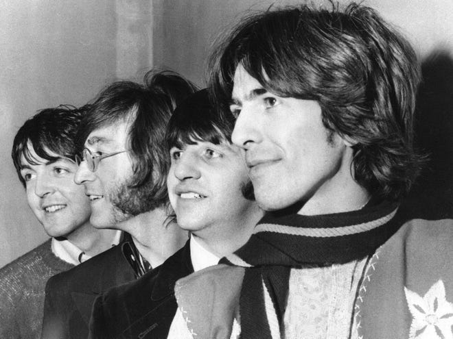 The Beatles (from left, Paul McCartney, John Lennon, Ringo Starr and George Harrison) pose together in 1968.