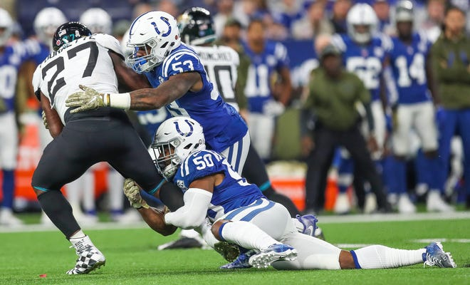 Indianapolis Colts middle linebacker Anthony Walker (50) and outside linebacker Darius Leonard (53) stop Jacksonville Jaguars running back Leonard Fournette (27) after a short gain at Lucas Oil Stadium on Sunday, Nov. 11, 2018.