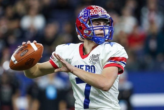 Western Boone Stars Spencer Wright (7) drops back to pass during the first half of IHSAA Class 2A state finals at Lucas Oil Stadium in Indianapolis, Friday.