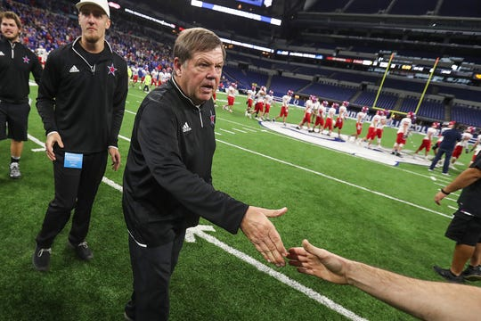 Western Boone assistant coach Denny Pelley, an Indiana Hall-of-Famer and former Speedway coach, is congratulated after the Stars won their first IHSAA Class 2A state championship since 1988, at Lucas Oil Stadium in Indianapolis, Friday, Nov. 23, 2018. The Stars defeated Eastbrook, 34-20.
