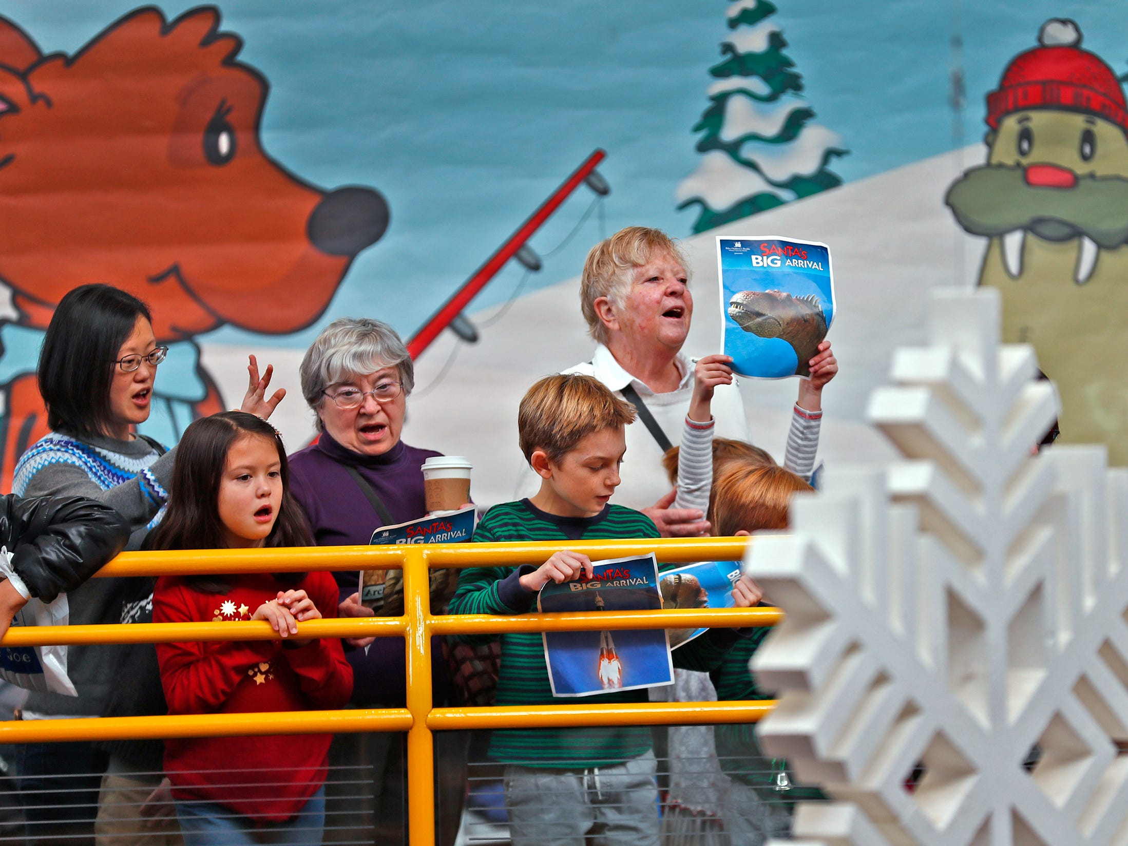 Families sing a Children's Museum rendition of 12 Days of Christmas at the Children's Museum of Indianapolis during the start of the Jolly Days Winter Wonderland celebration, Friday, Nov. 23, 2018.